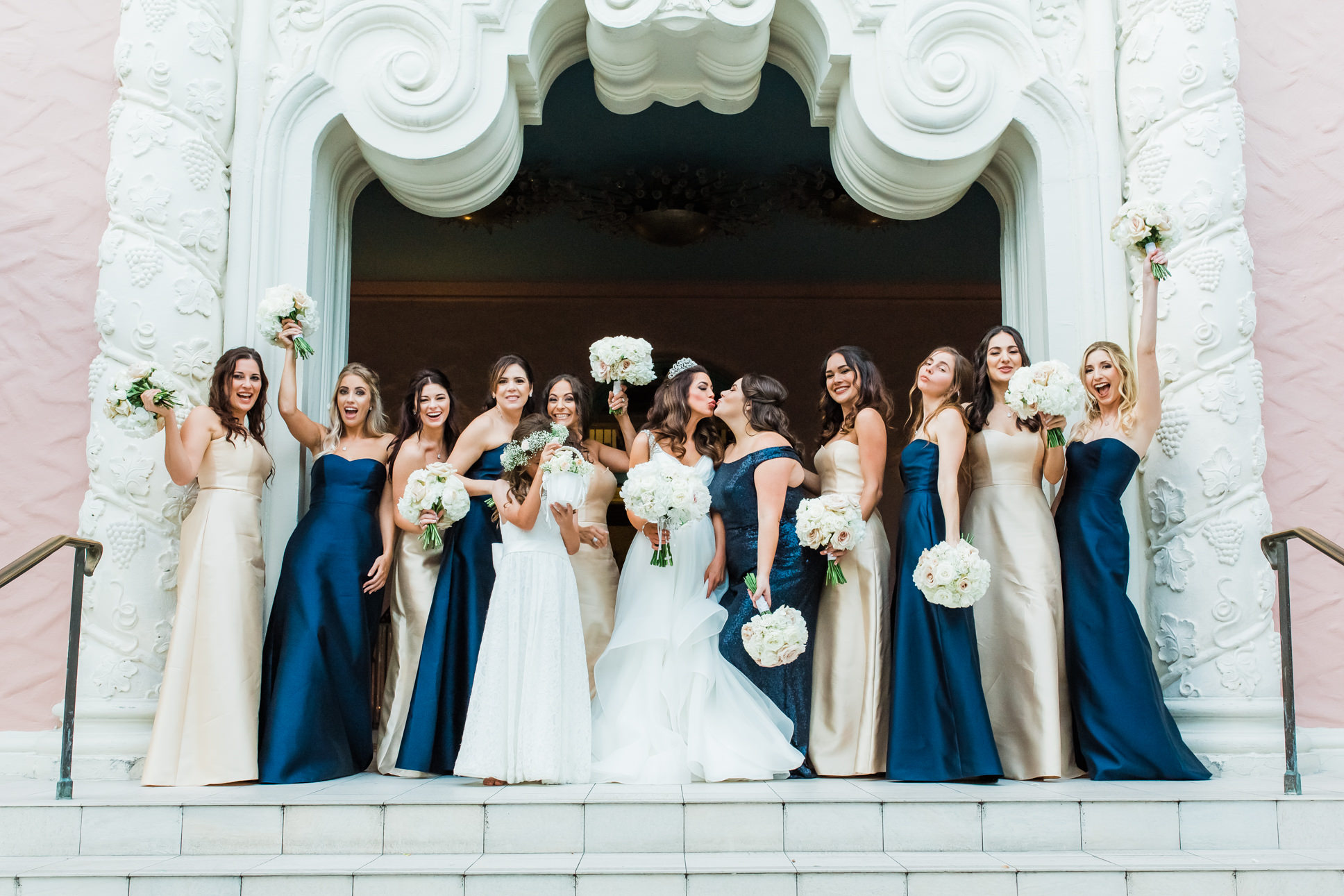St. Pete Bride in Hayley Paige Wedding Dress, Bridesmaids in Mix and Match Navy Blue and Gold Dresses, Flower Girl in White Dress Fun Bridal Party Portrait