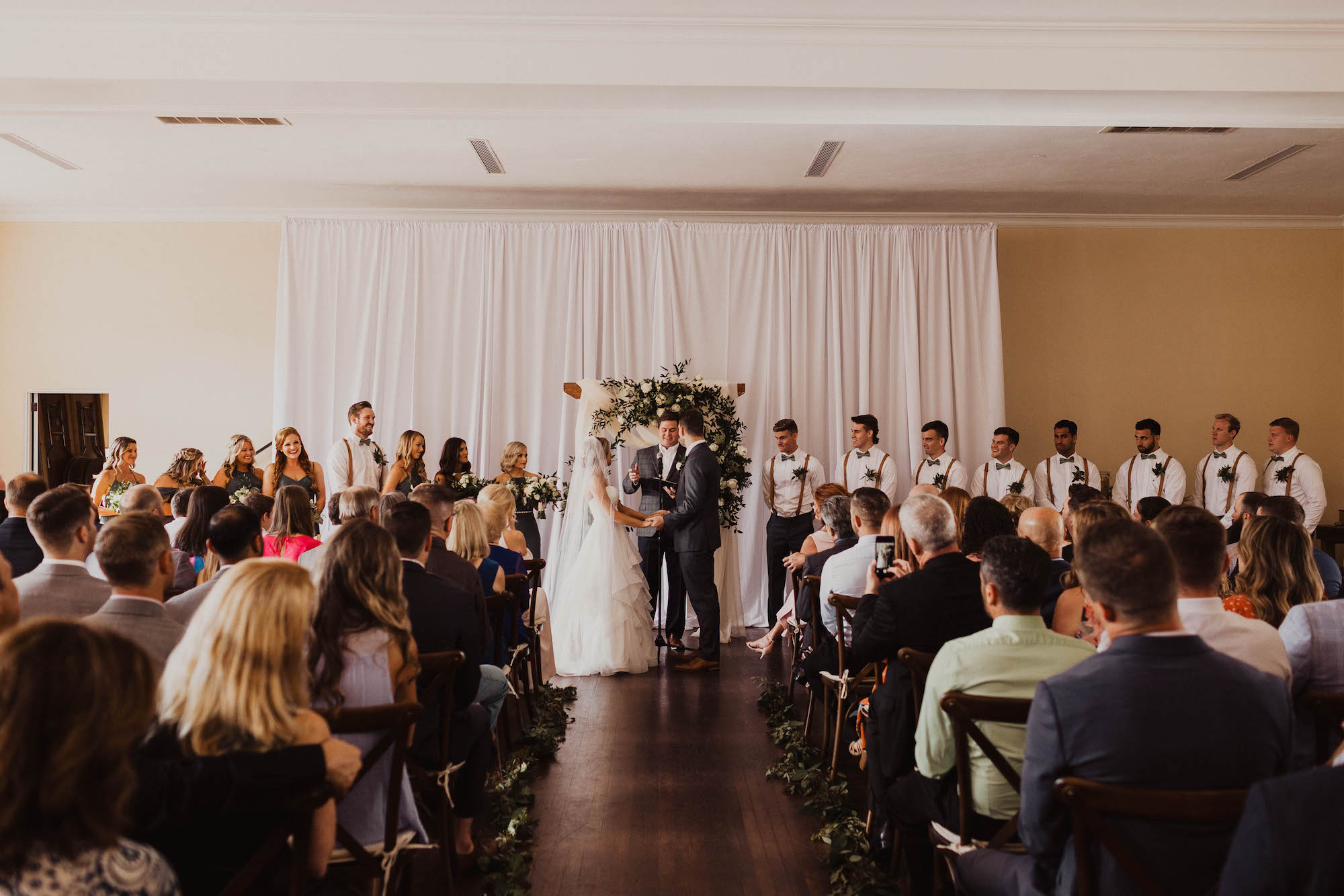Bride and Groom Exchanging Wedding Vows During Ceremony Portrait | Tampa Bay Wedding Venue The Orlo