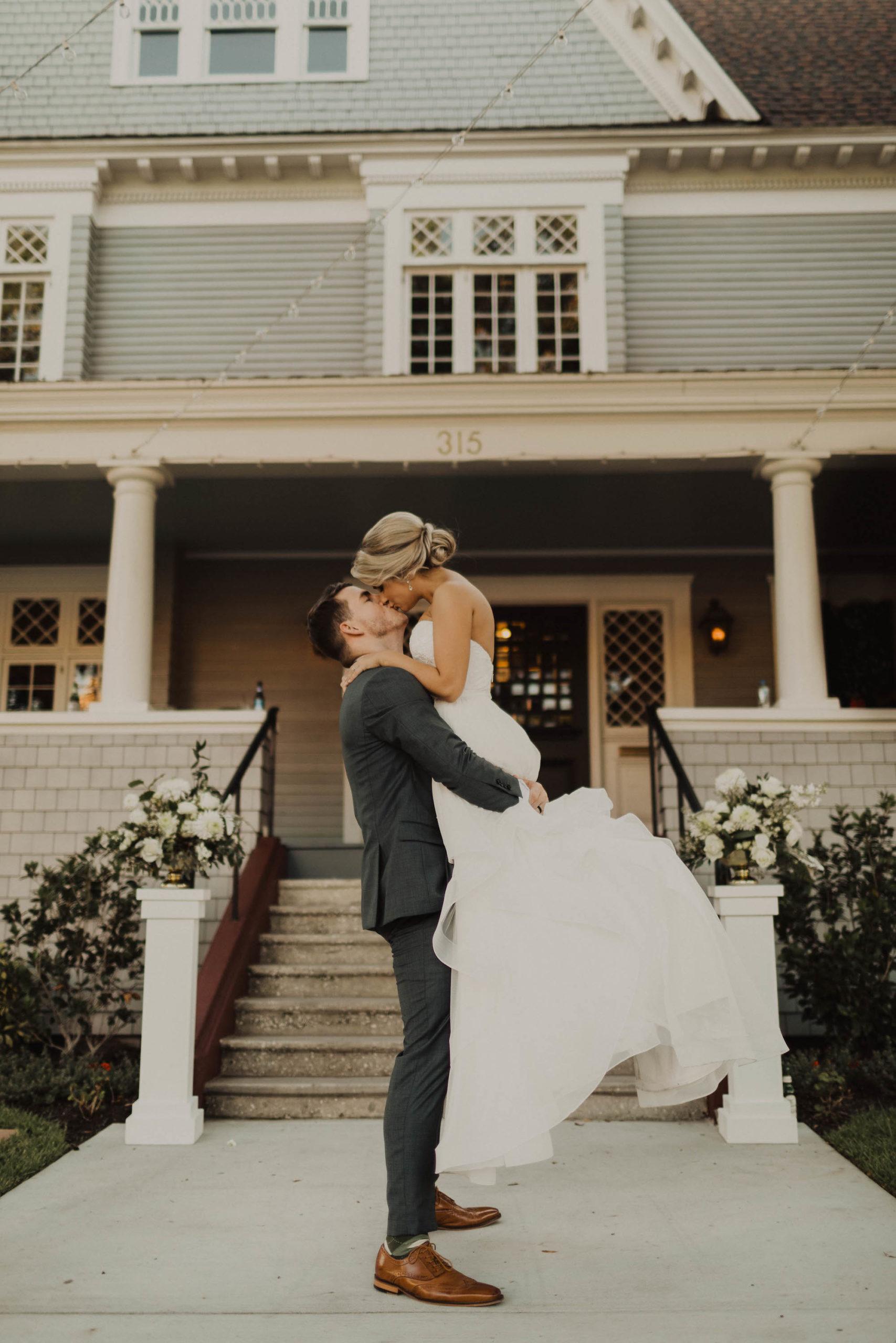 Romantic Bride and Groom Kissing Wedding Portrait Outside Tampa Bay Wedding Venue The Orlo