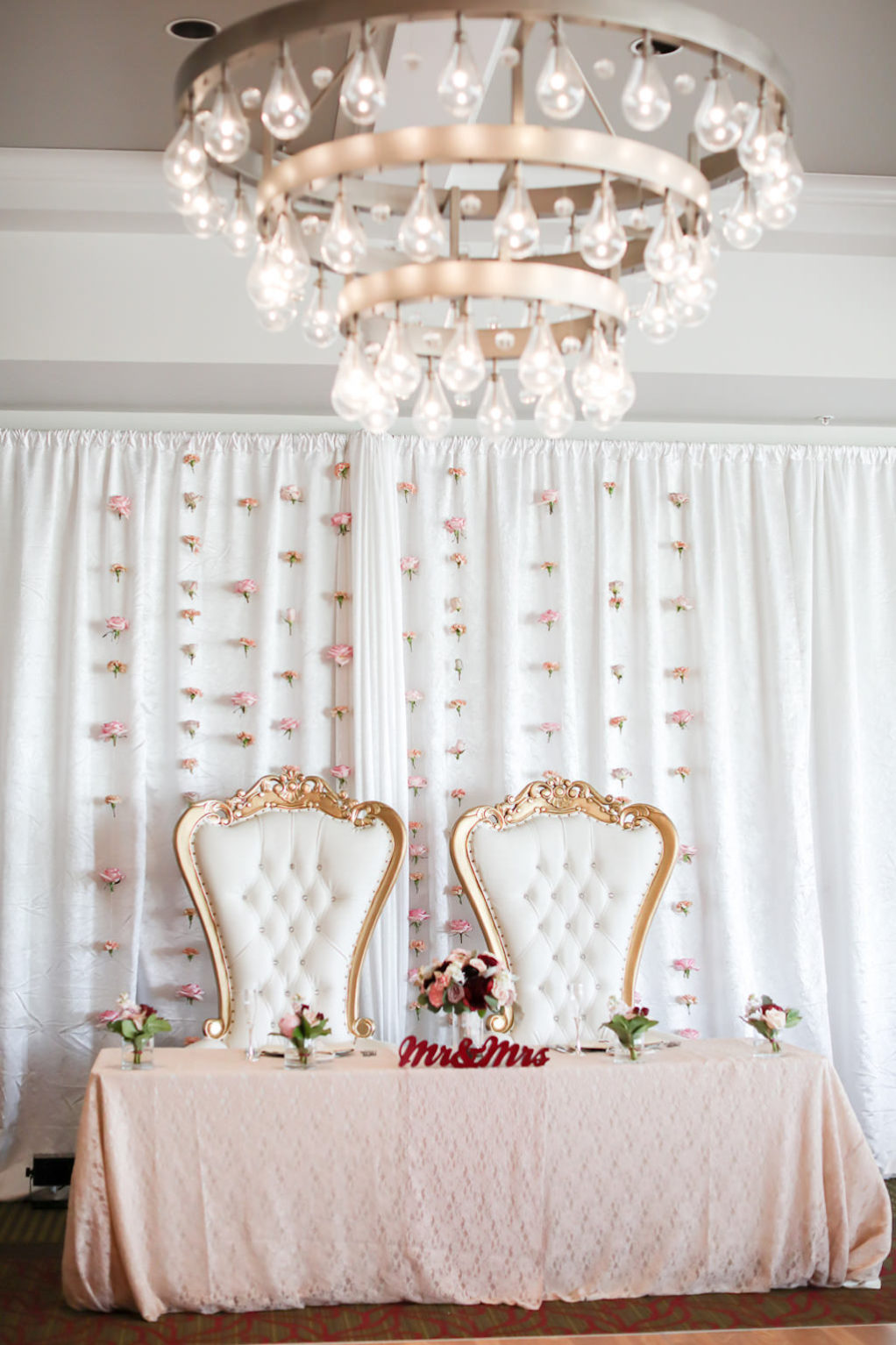 Romantic Antique Gold and Ivory Cushion Chairs, Sweetheart Table with Dusty Rose Table Linen, Red Mr and Mrs Sign, White Draping with Blush Pink Hanging Flowers | Wedding Photographer Lifelong Photography Studios | Tampa Bay Wedding Planner Blue Skies Weddings and Events | St. Petersburg Hotel Wedding Venue The Birchwood | Over the Top Rental Linens