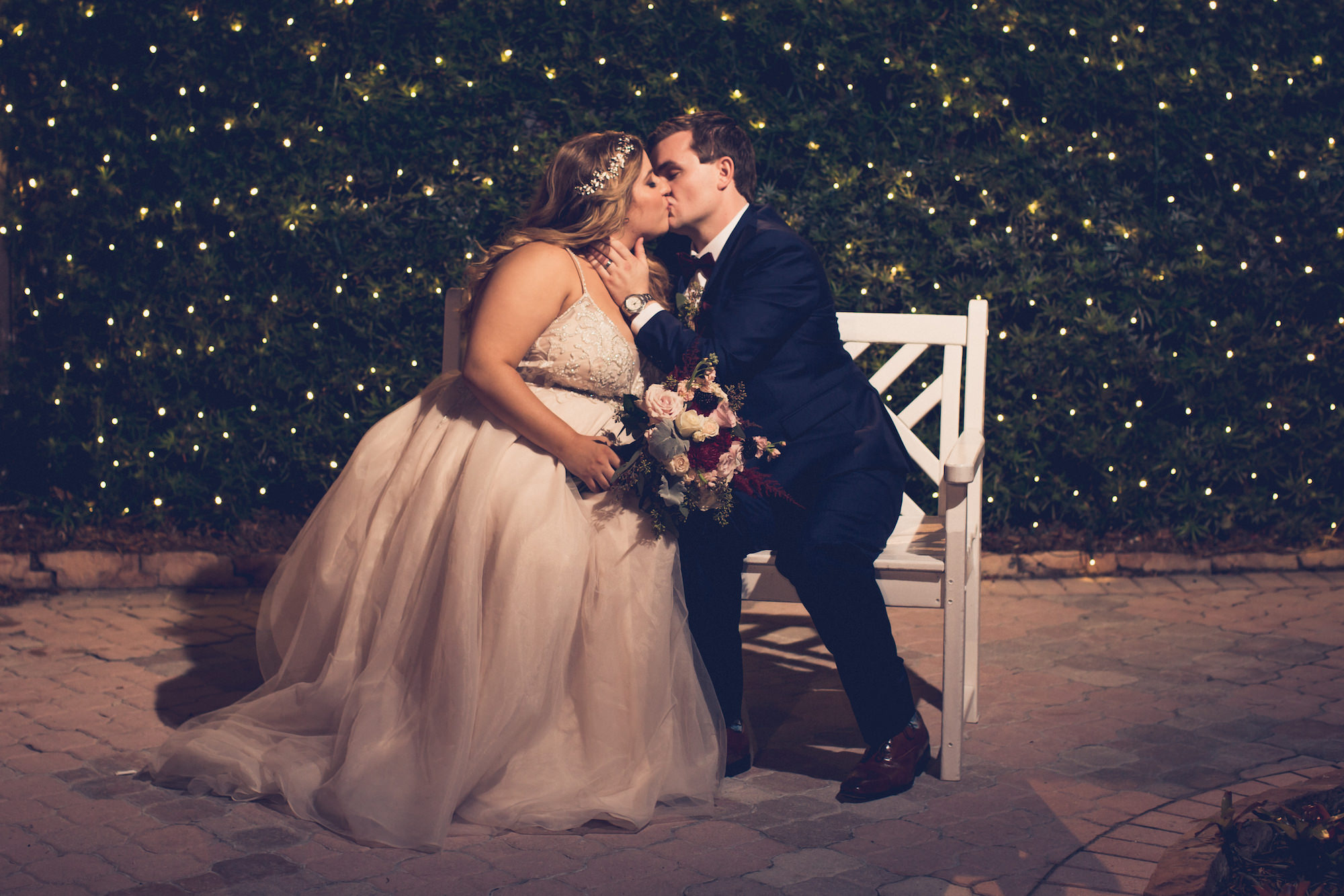 Romantic Bride and Groom Wedding Portrait with Twinkle Lights Greenery Backdrop | Wedding Photographer Luxe Light Images | Historic Pink Palace St. Pete Waterfront Wedding Venue The Don CeSar