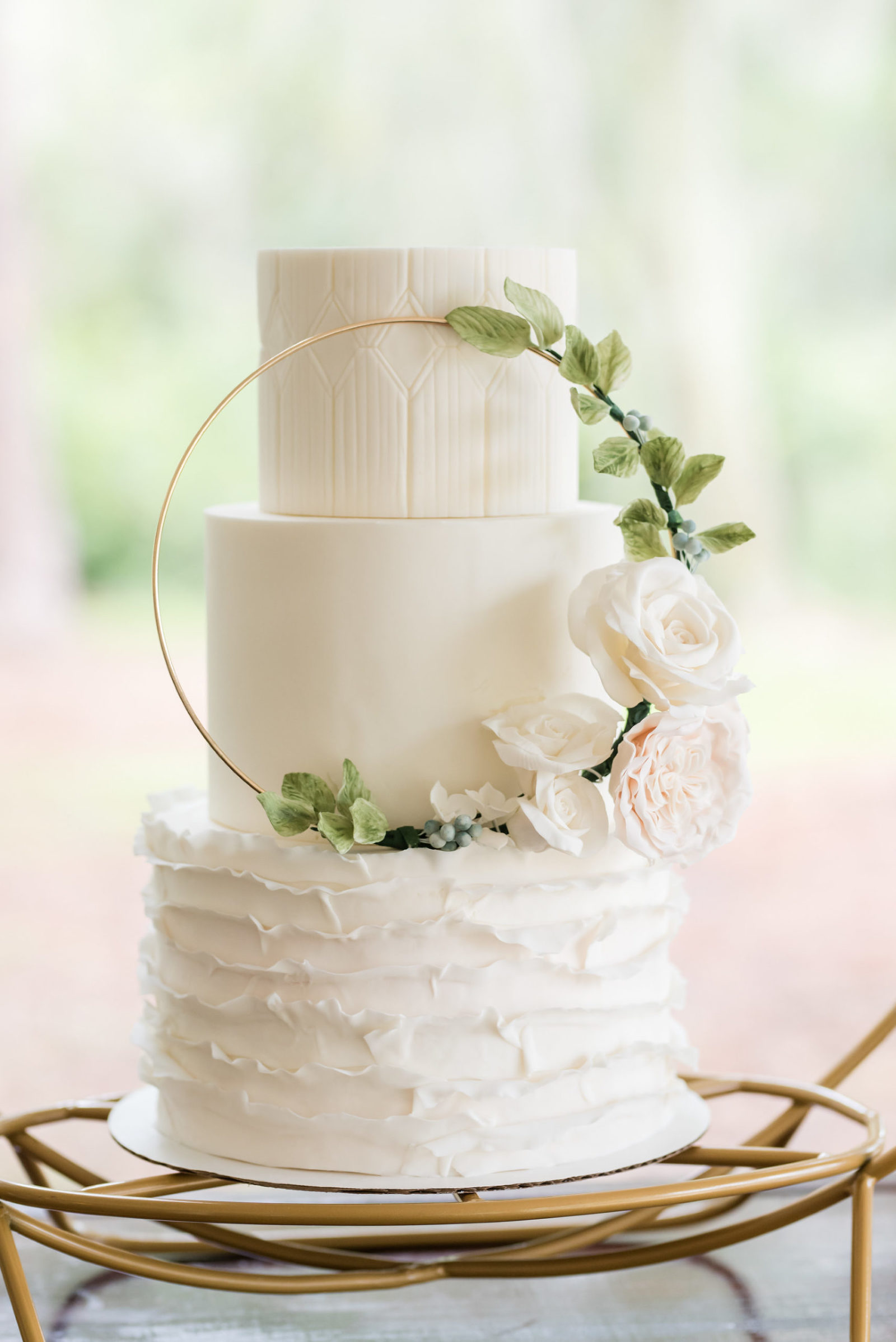 Dusty Rose Styled Wedding Shoot, Three Tier White Ruffled Bottom Tier Wedding Cake with Gold Circular Ornament with Greenery Leaves, Blush Pink and White Roses | Tampa Bay Wedding Planner Elegant Affairs by Design | Wedding Baker Tampa Bay Cake Company