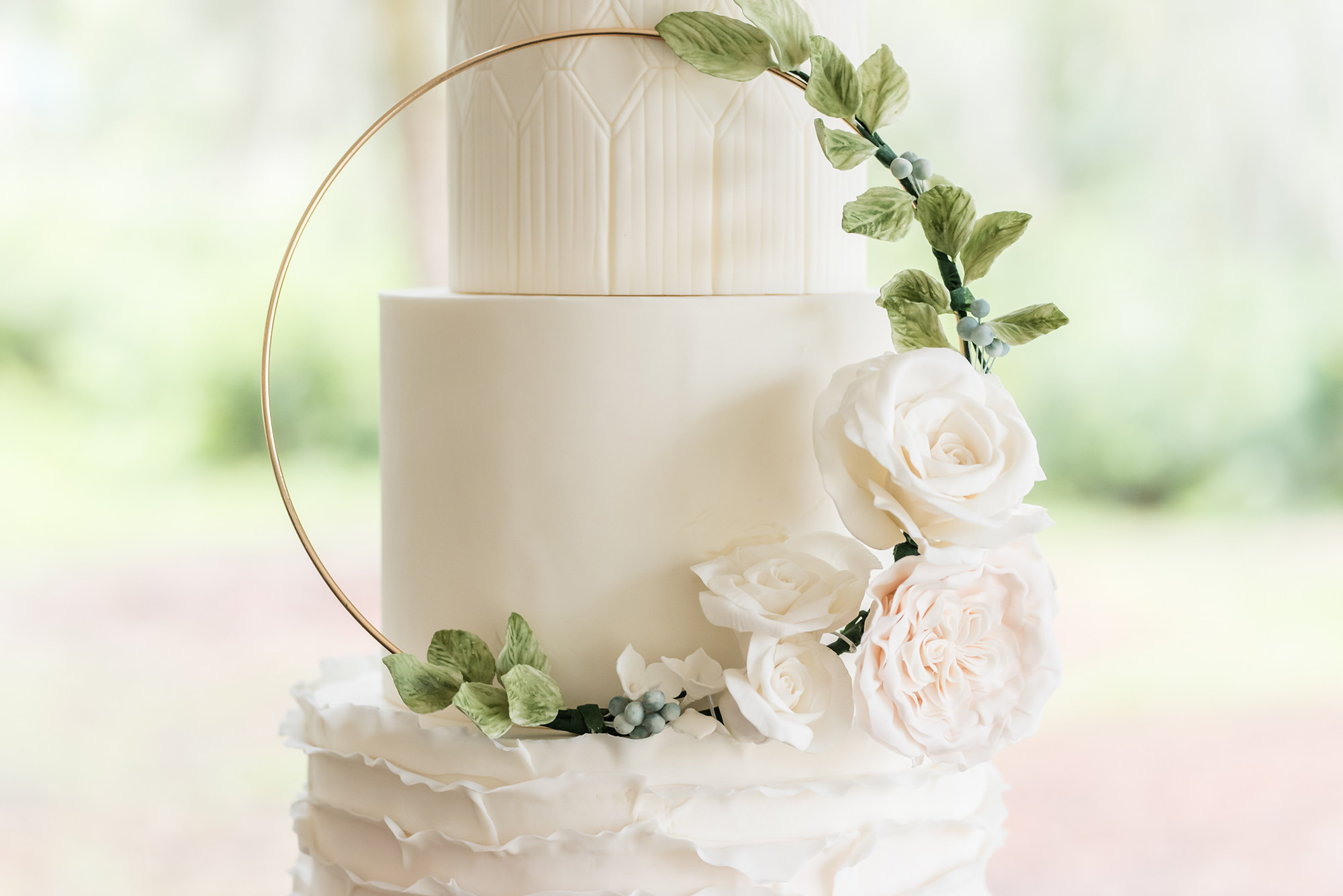 Dusty Rose Styled Wedding Shoot, Three Tier White Ruffled Bottom Tier Wedding Cake with Gold Circular Ornament with Greenery Leaves, Blush Pink and White Roses   Tampa Bay Wedding Planner Elegant Affairs by Design   Wedding Baker Tampa Bay Cake Company