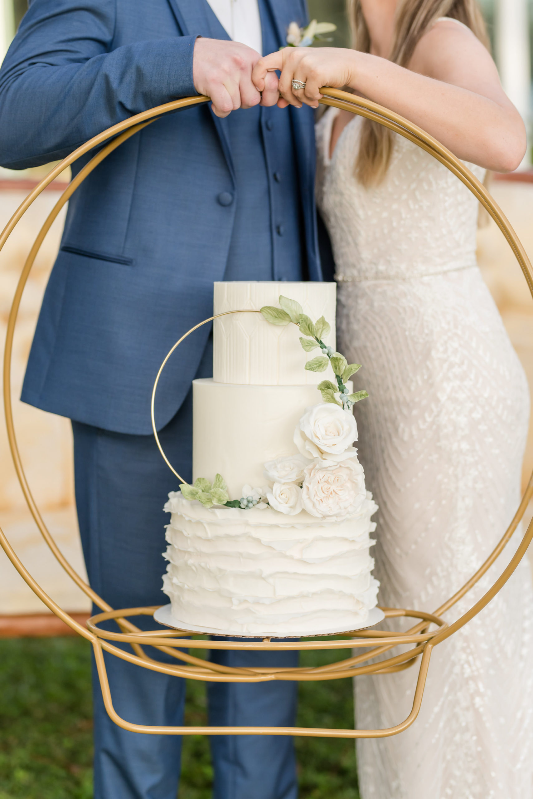 Dusty Rose Styled Wedding Shoot, Round Gold Hoop Wedding Cake Stand with Three Tier Classic Modern Wedding Cake with Ruffled Bottom Tier, Gold Circle with Green Leaves and Roses   Tampa Bay Wedding Planner Elegant Affairs by Design   Wedding Baker Tampa Bay Cake Company