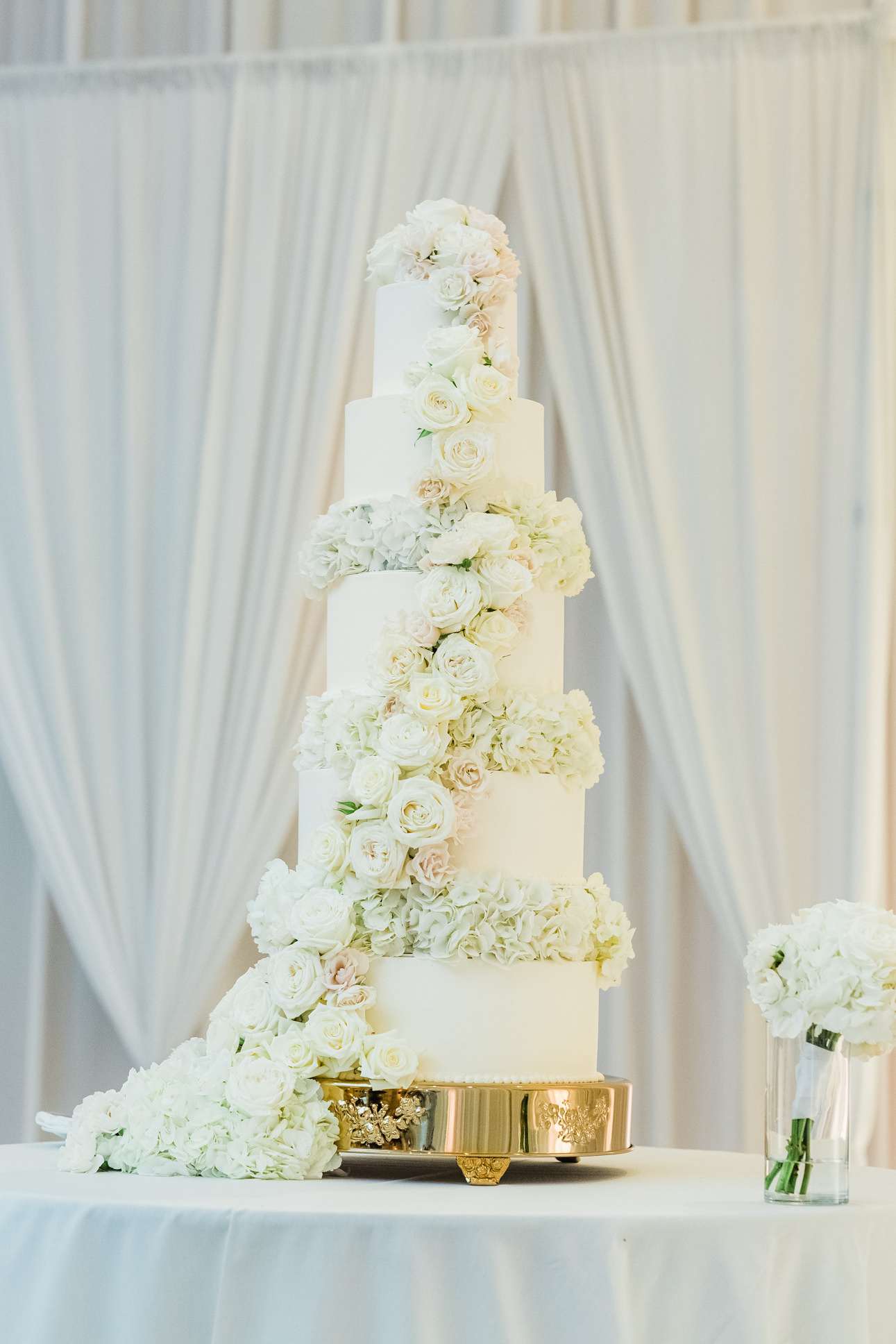 Elegant Classic Five Tier White Wedding Cake with Ivory and Blush Pink Roses Lush Cascading Flowers on Gold Cake Stand   Wedding Caterer and Cake St. Pete Vinoy Renaissance