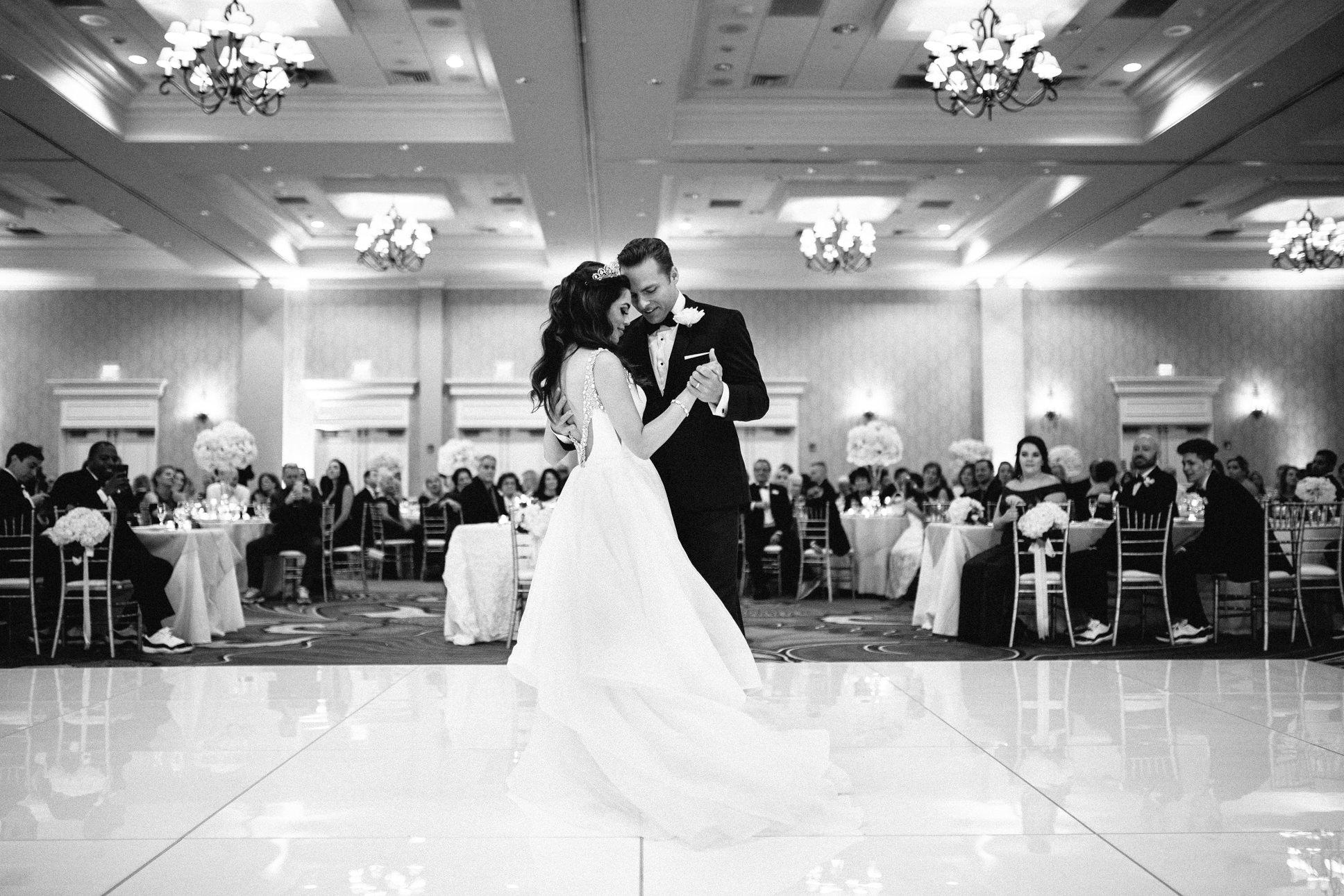Black and White Romantic Bride and Groom First Dance Wedding Portrait   Tropical Waterfront Hotel Ballroom Wedding Venue The Vinoy Renaissance St. Pete Resort & Golf Club   Tampa Bay Wedding DJ Grant Hemond & Associates