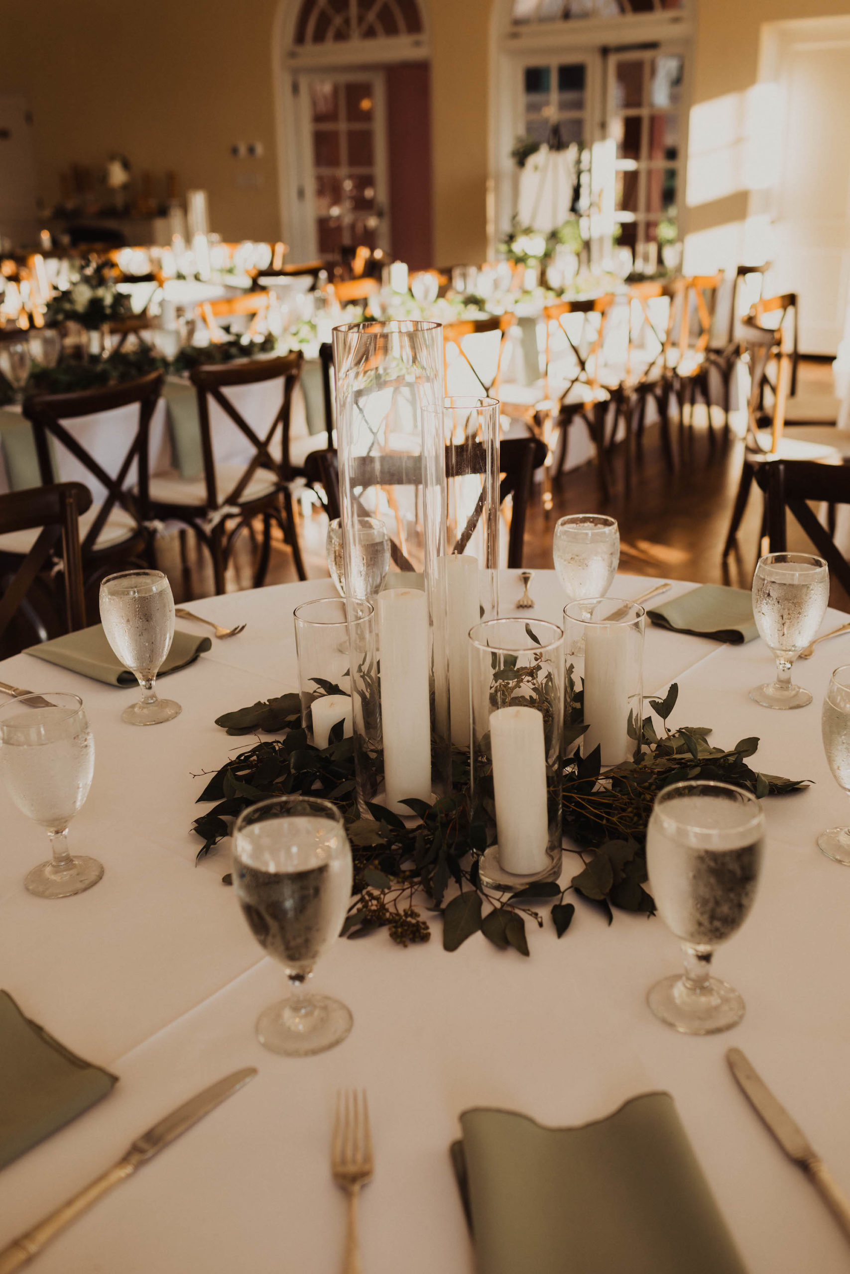 Simple, Elegant Wedding Reception Decor, Hurricane Glass Cylinder Vases and Candles with Eucalyptus Wreath | South Tampa Wedding Venue The Orlo