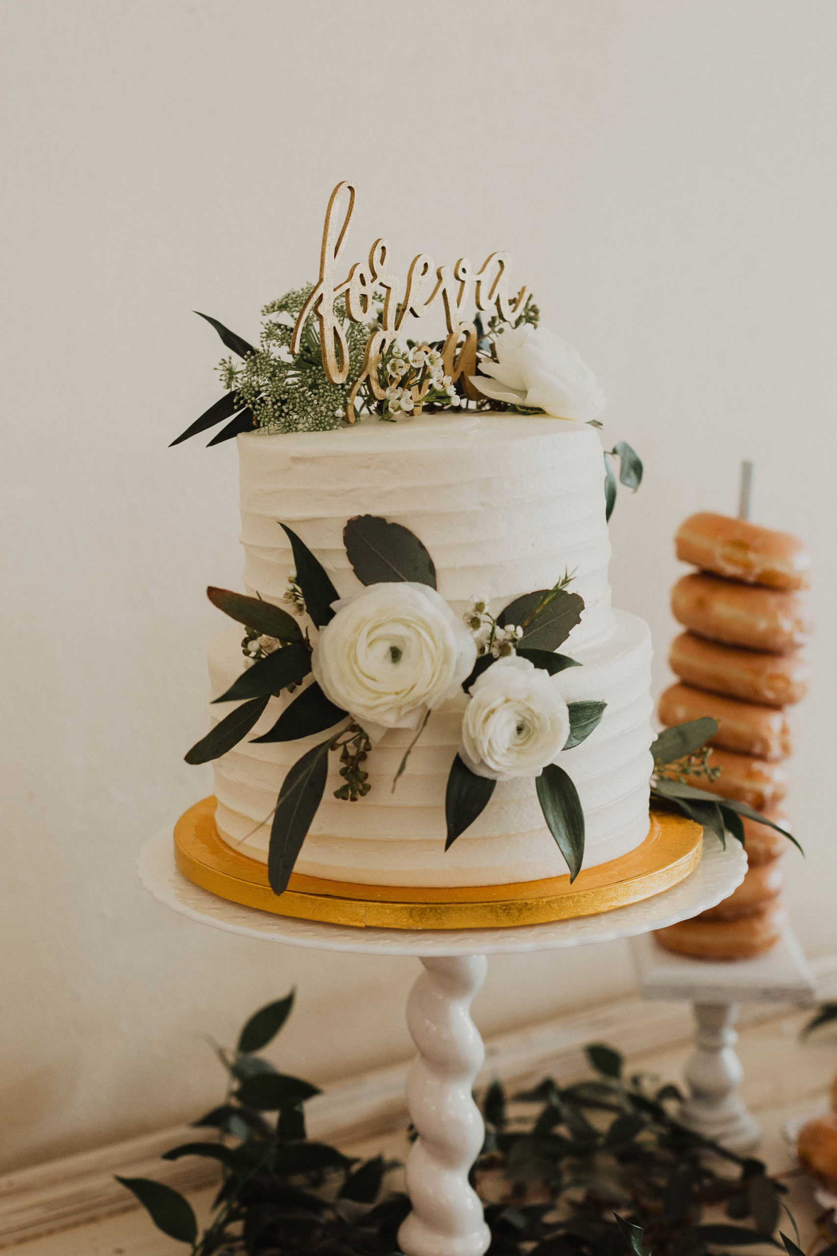 Two Tier Simple Ruffled Wedding Cake with Garden Roses and Eucalyptus