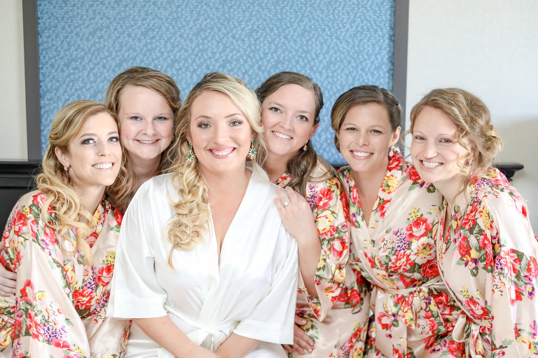 St. Pete Bride and Bridesmaid Getting Ready Photo, Champagne Gold Silk Robes with Red Floral Design, Bride Wearing Emerald Earrings | Florida Wedding Photographer Lifelong Photography Studios