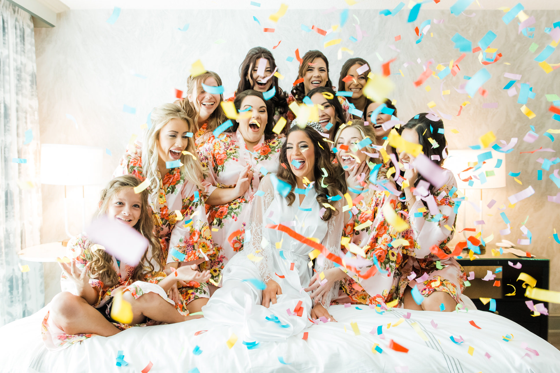 Tampa Bride and Bridesmaids in Floral Robes Fun Colorful Confetti Getting Wedding Ready Portrait