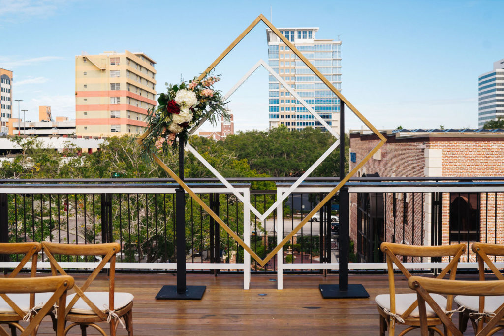 St. Petersburg Florida Wedding | St. Pete Venue Red Mesa Events | Rooftop Geometric Gold Ceremony Arch Backdrop