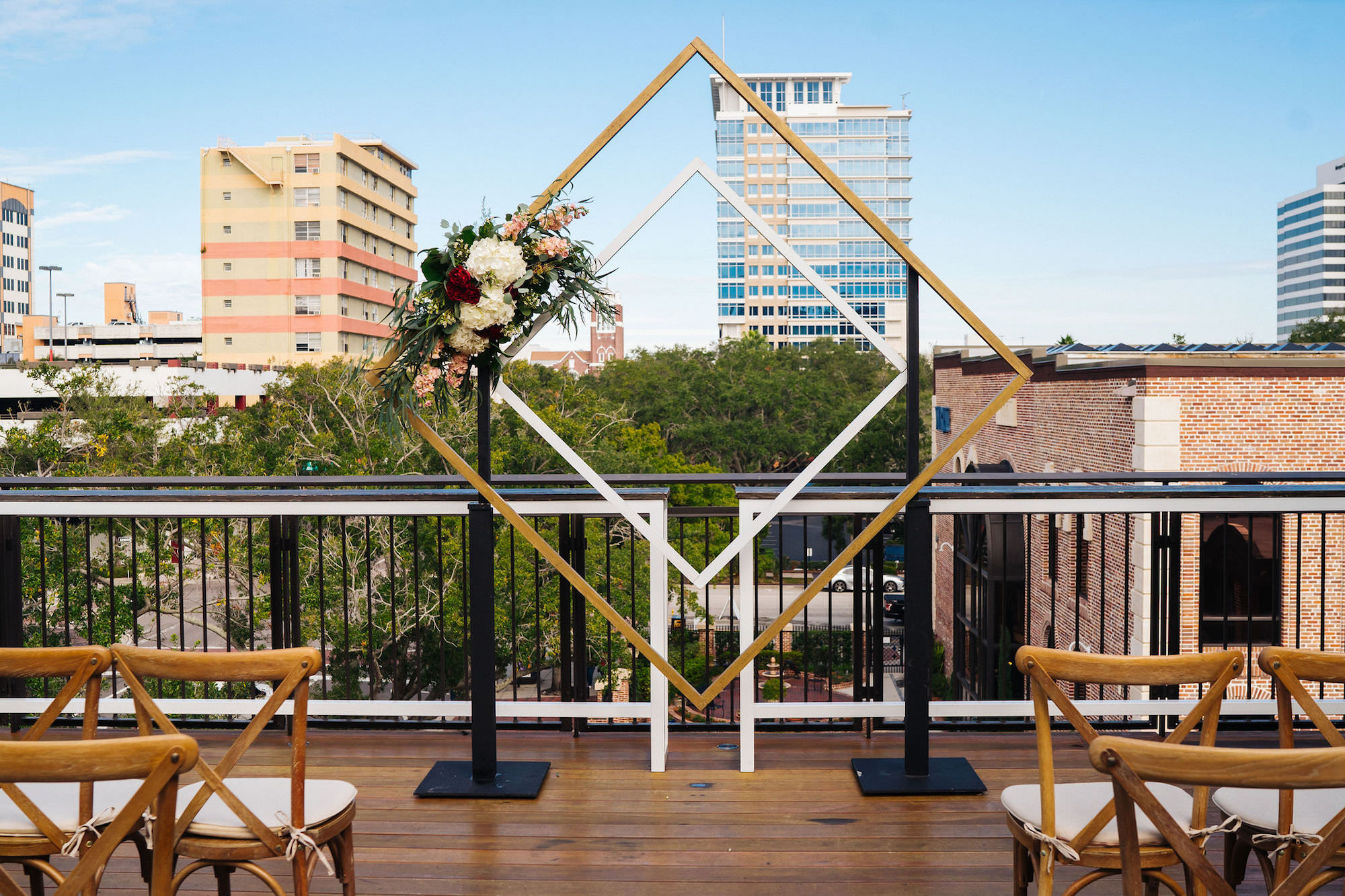 St. Petersburg Florida Wedding   St. Pete Venue Red Mesa Events   Rooftop Geometric Gold Ceremony Arch Backdrop