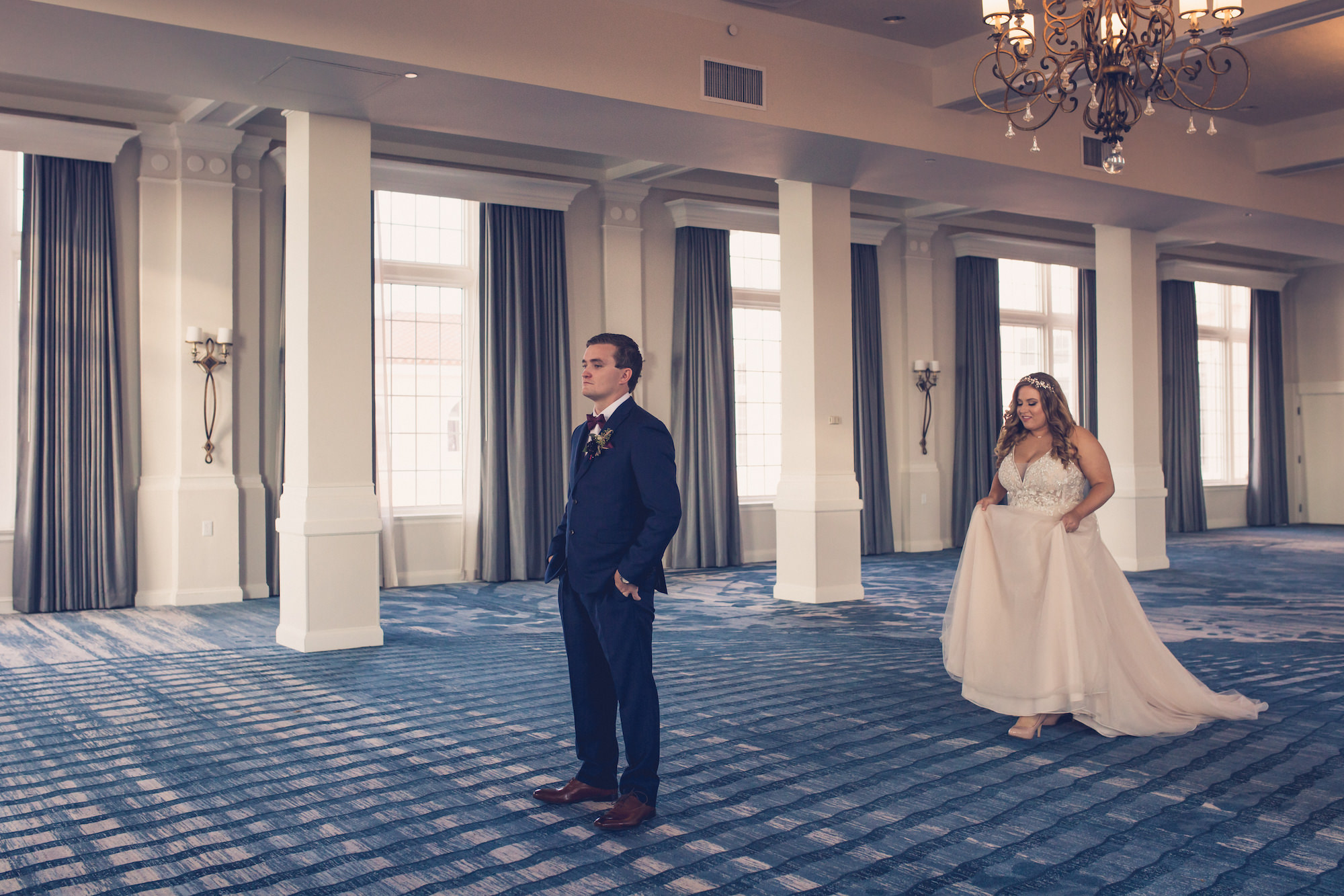 Tampa Bride and Groom First Look Wedding Portrait in The Pink Palace Historic St. Pete Wedding Venue The Don CeSar | Wedding Photographer Luxe Light Images