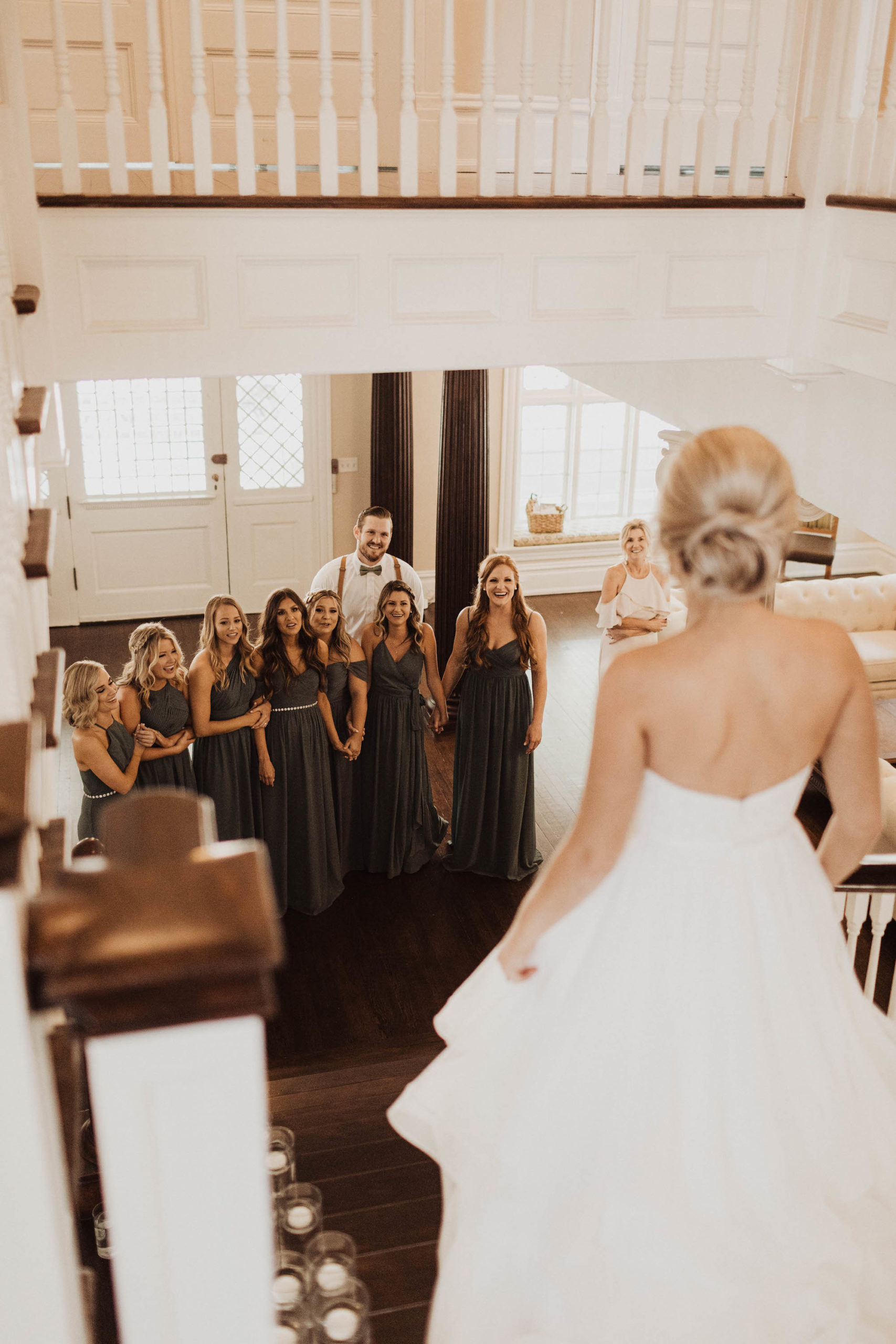 Tampa Bay Bridal Party First Look Wedding Portrait with Bride, Bridesmaids Wearing Mix and Match Green Dresses