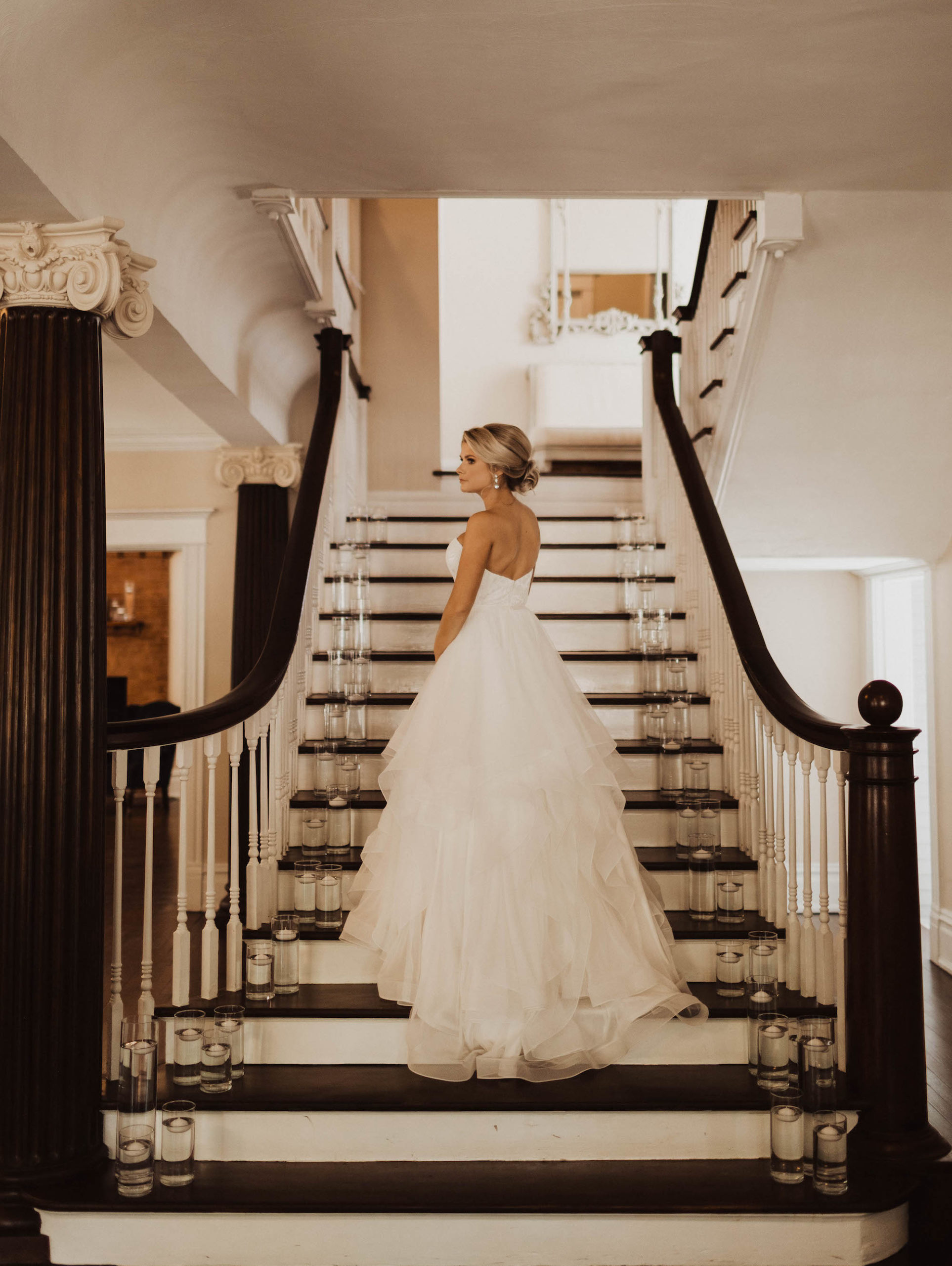 Tampa Bay Beauty Bridal Wedding Portrait on Staircase in Mikaella Ballgown Lace and Mesh Tulle Cascading Ruffle Wedding Dress