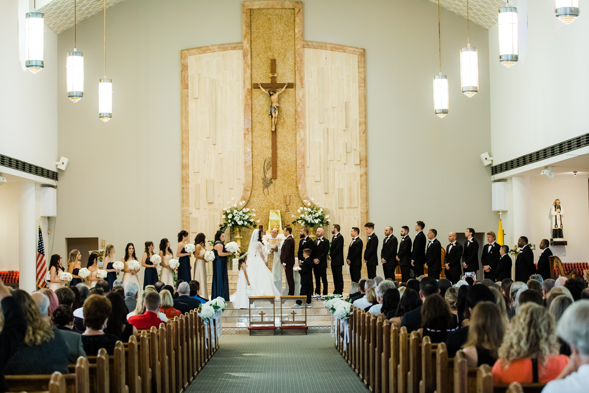 Traditional Bride and Groom Exchanging Wedding Vows During Ceremony   St. Pete Beach Wedding Venue St. John Vianney Catholic Church