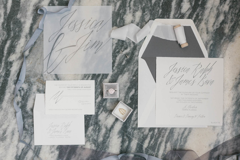 Elegant Classic White and Gray Wedding Invitation Suite on Marble Backround, Round Diamond Engagement Ring in Velvet The Mrs. Ring Box