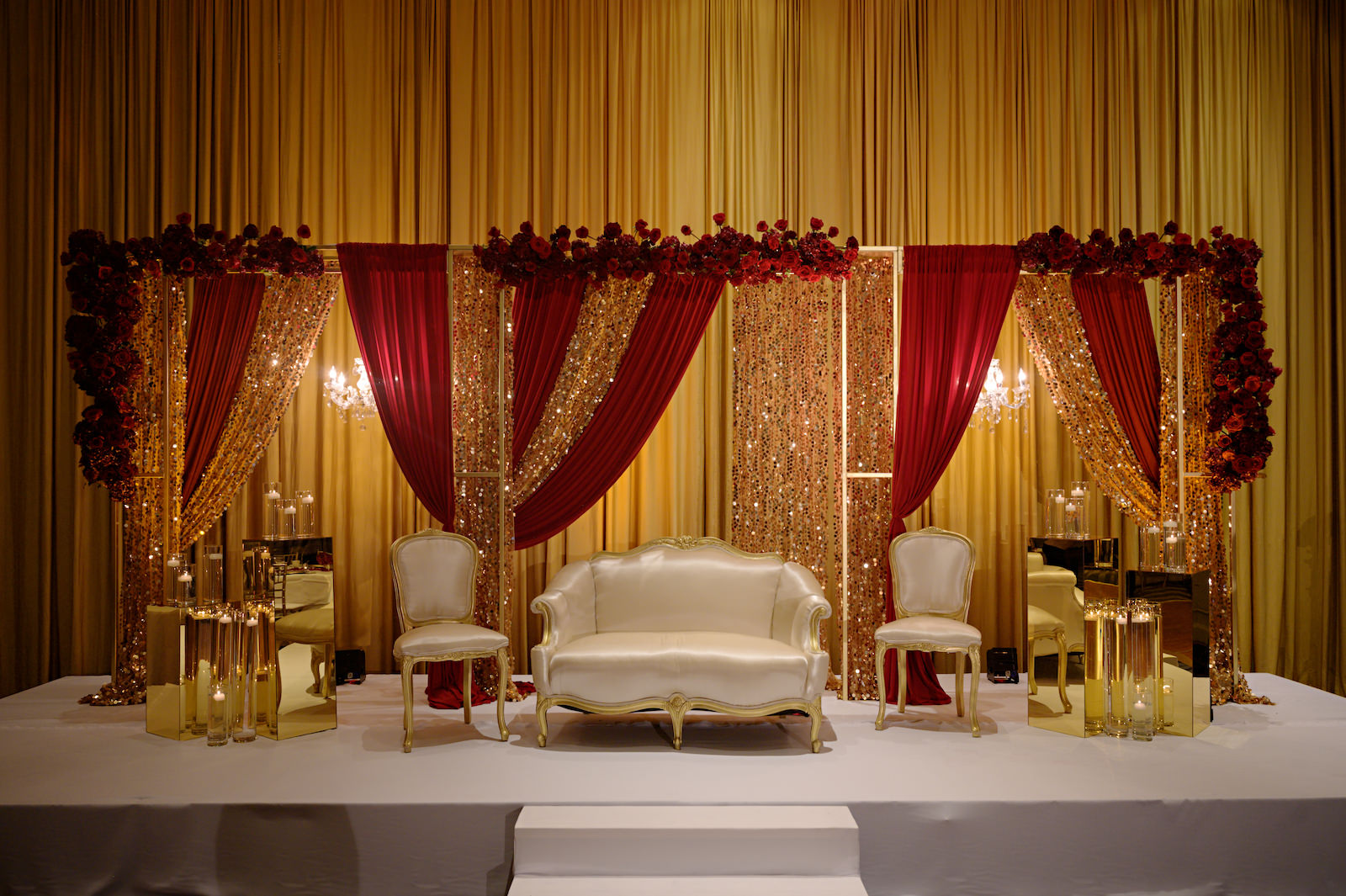 Elegant Florida Multicultural Indian Catholic Wedding Mandap with Burgundy Red Draping and Gold Sequin Backdrop, Wedding Reception Decor