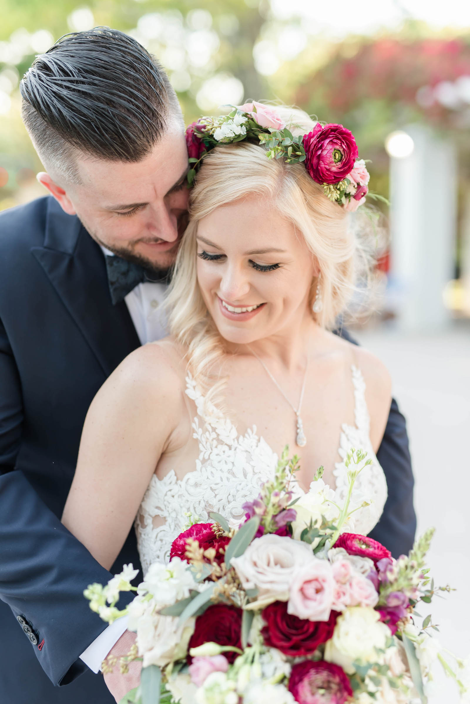 Bridal and Groom Portrait   Stella York Lace Sheath Spaghetti Strap Empire Waist Wedding Dress Bridal Gown   Bride Wedding Bouquet and Halo Crown with Blush Pink Dusty and Burgundy Rose Garden Roses, Snapdragons, Stock, and Eucalyptus Greenery   Groom Classic Black Suit Tux
