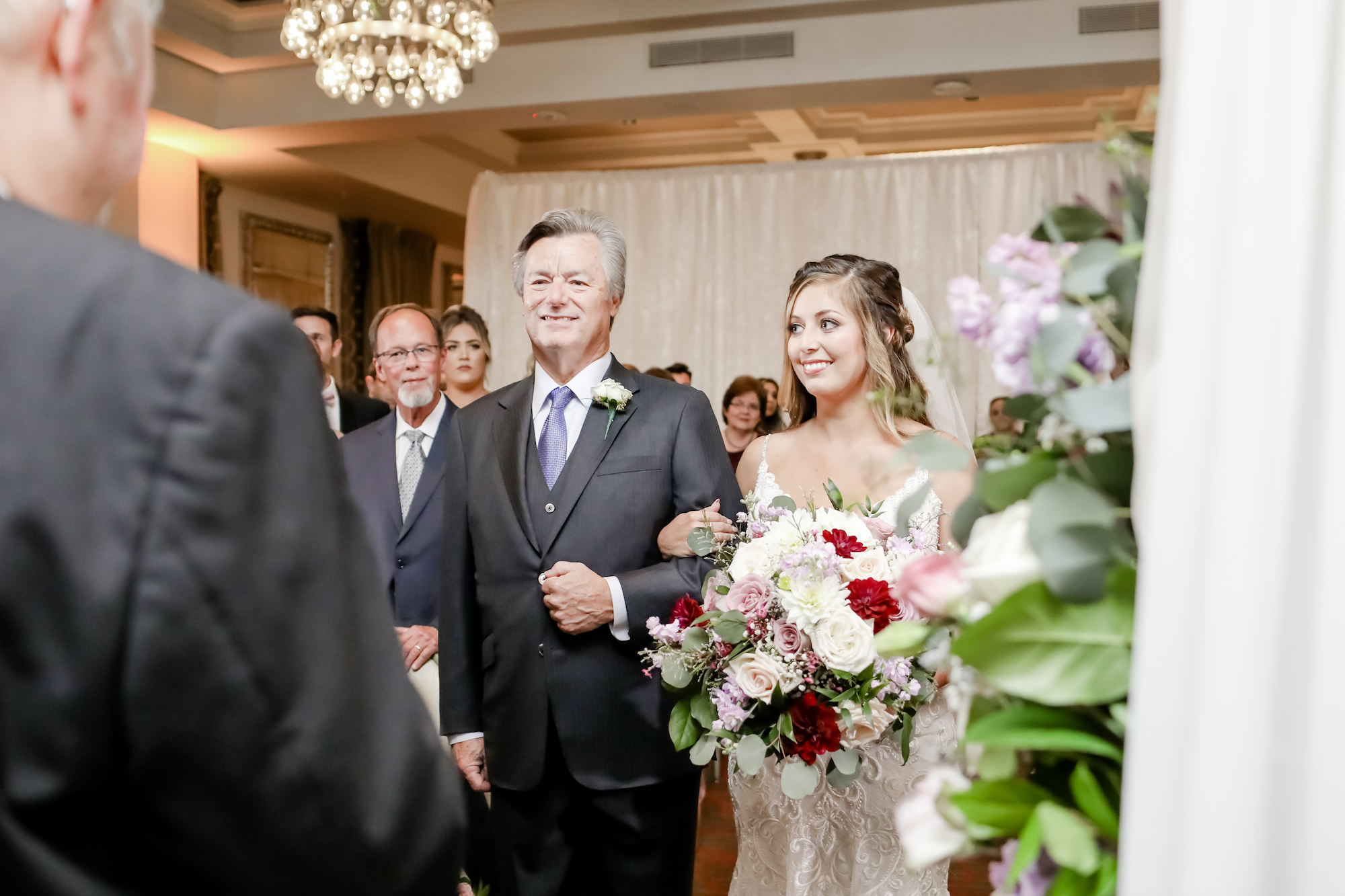 Tampa Bay Bride and Father Walk Down the Aisle Portrait, Bride Holding Romantic Floral Wedding Bouquet with Red, White and Mauve Roses, Purple Flowers with Greenery and Eucalyptus   Downtown St. Pete Wedding Planner Blue Skies Weddings and Events   Florida Wedding Photographer Lifelong Photography Studio