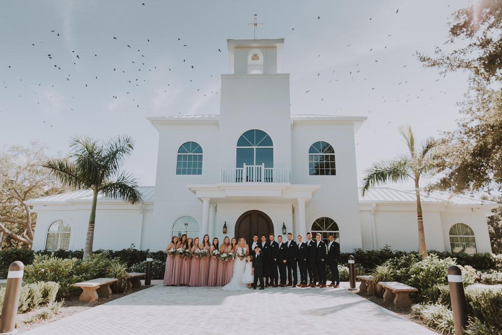 Wedding Party Group Portrait Shot | Clearwater Wedding Venue Harborside Chapel | Blush Pink Dusty Rose Azazie Bridesmaid Dresses | Classic Black Tux Suit