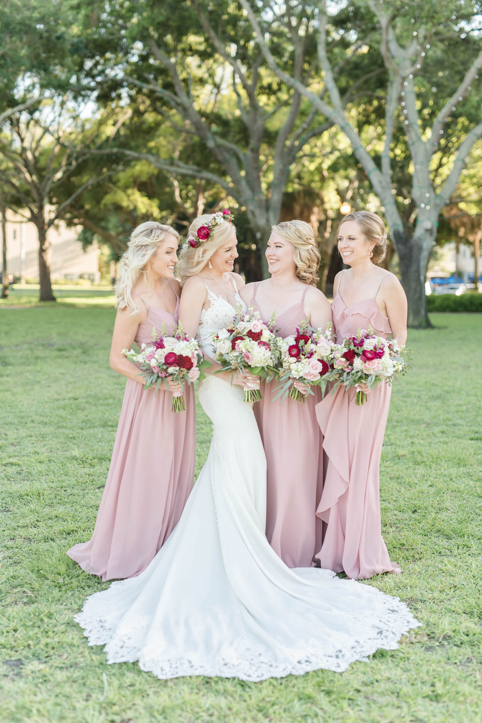 Bride and Bridesmaids Portraits   Blush Pink Dusty Rose Mismatched Chiffon Bridesmaid Dresses   Stella York Lace Sheath Spaghetti Strap Empire Waist Wedding Dress Bridal Gown   Bride Wedding Bouquet and Halo Crown with Blush Pink Dusty and Burgundy Rose Garden Roses, Snapdragons, Stock, and Eucalyptus Greenery
