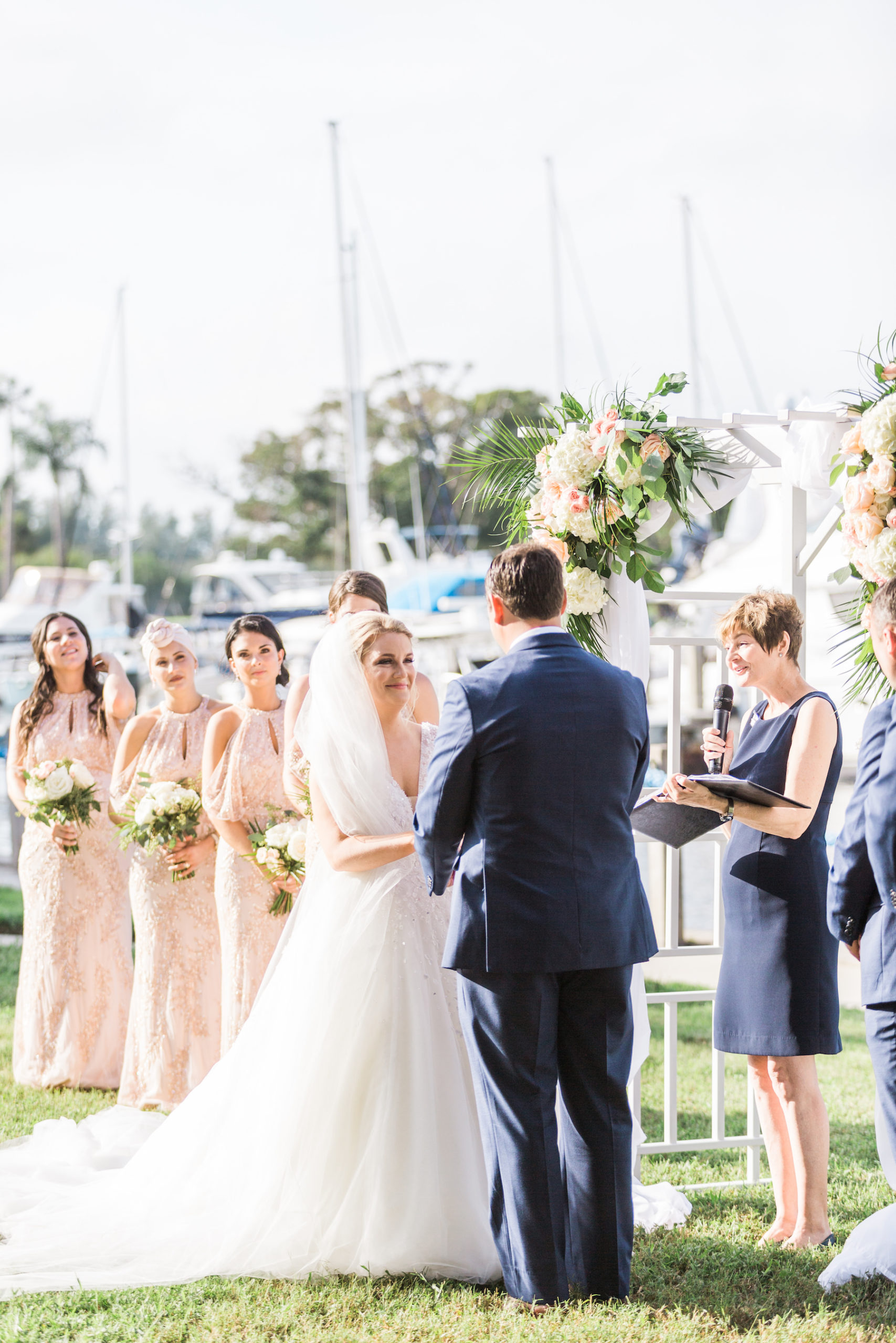 Peach, Pink, and White Tropical Wedding Ceremony Arch Decor with Greenery | Sarasota Wedding Officiant A Wedding with Grace