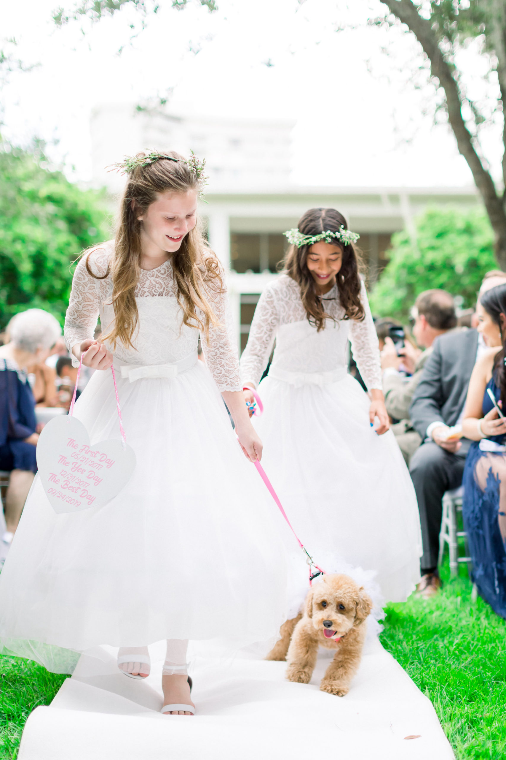 Flower Girls in Matching Lace and Tulle Dresses with Greenery Floral Crowns Walking with Poodle Dog | Wedding Venue Tampa Garden Club | Wedding Photographer Shauna and Jordon Photography | Pet Planner FairyTail Pet Care