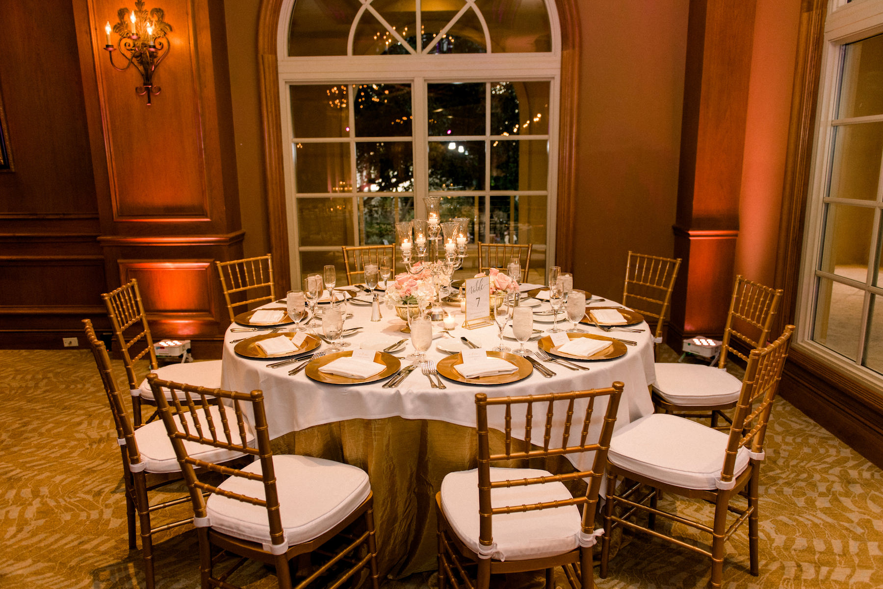 Classic Elegant Ballroom Wedding Reception Decor, Round Table with Gold and White Linens, Gold Chiavari Chairs, Chargers, Tall Candelabra Centerpiece | Hotel Wedding Venue Ritz Carlton Sarasota | Tampa Wedding Planner Special Moments Event Planning