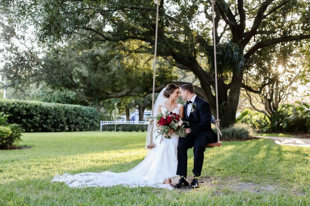 Bride and Groom Sunset Wedding Portrait on Outdoor Swing | Wedding Photographer Lifelong Photography Studio | Wedding Planner Blues Skies Weddings and Events | Tampa Wedding Venue Davis Islands Garden Club