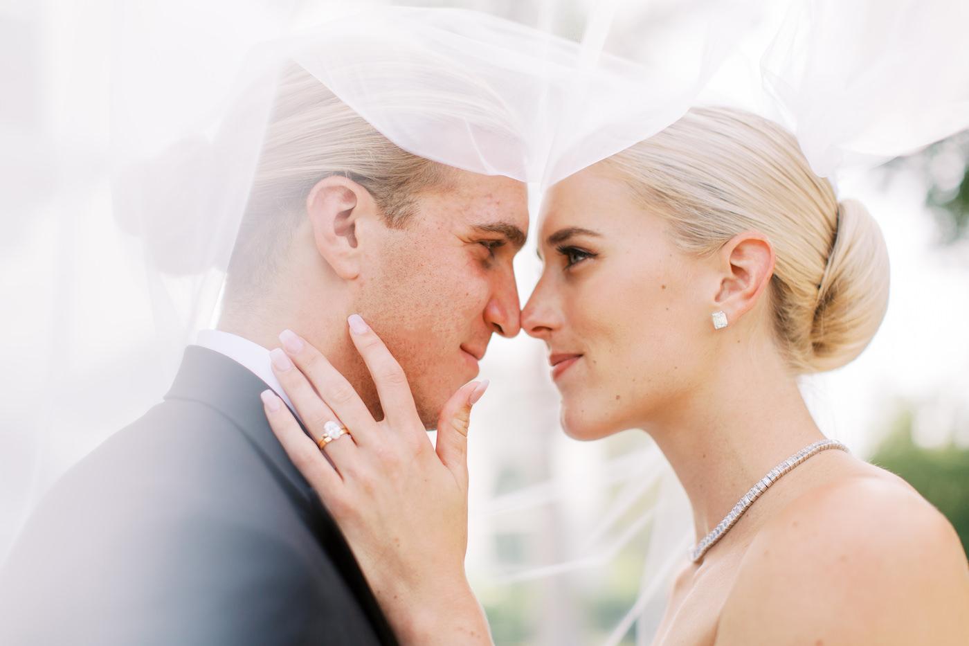 Romantic Classic Timeless Bride and Groom Wedding Portrait Under Wedding Veil