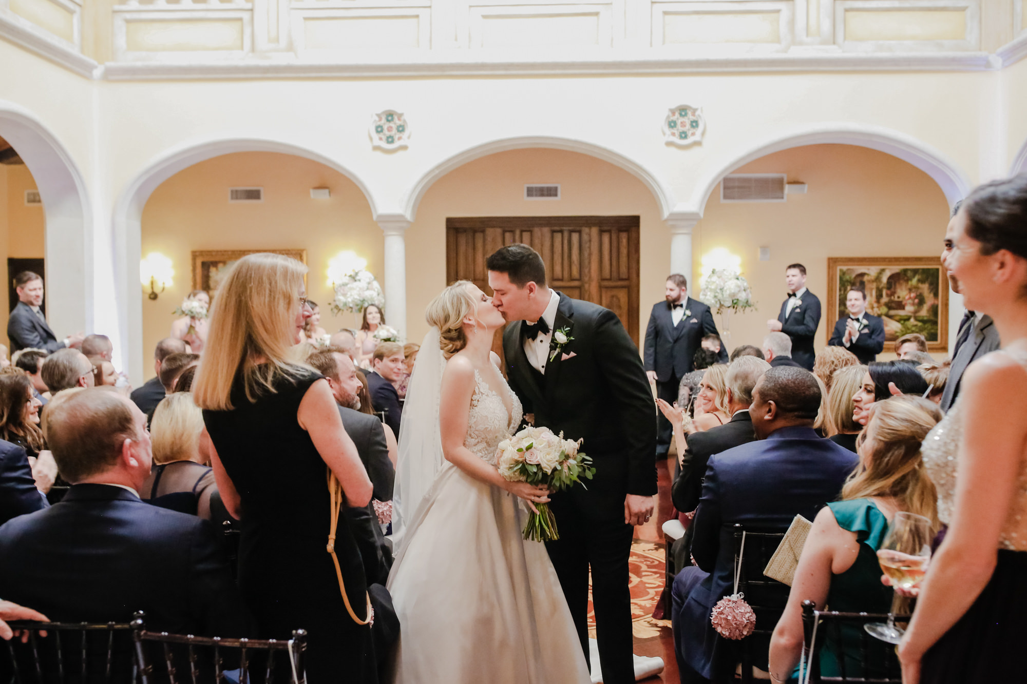 Tampa Wedding Venue Avila Golf & Country Club | Indoor Ceremony | Bride and Groom First Kiss