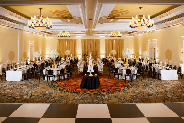 Classic Timeless Modern Ballroom Wedding Reception Decor, Black and White Checkered Dance Floor, Long Tables with White and Black Linens, Black Chairs, Tall Gold Vases with White Floral Centerpieces | Tampa Bay Wedding Planner Parties A'la Carte | Wedding Reception Venue Clearwater Beach Sandpearl Resort