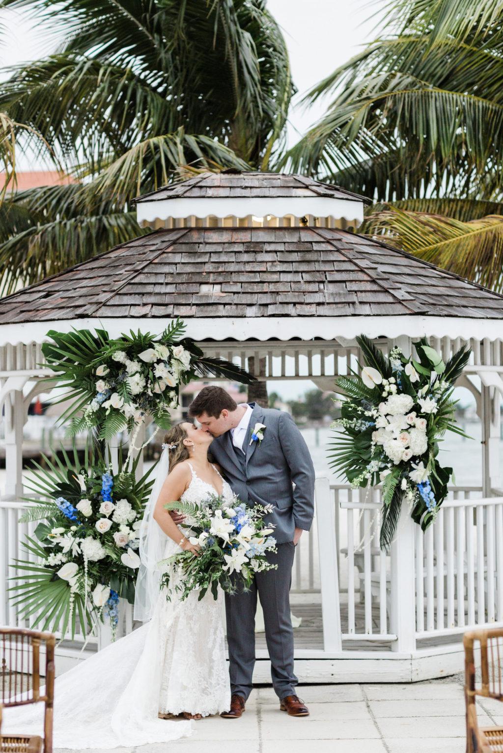 Bride and Groom Portraits at Beach Wedding Gazebo with Tropical Floral Arrangements | St. Pete Wedding Venue Isla Del Sol