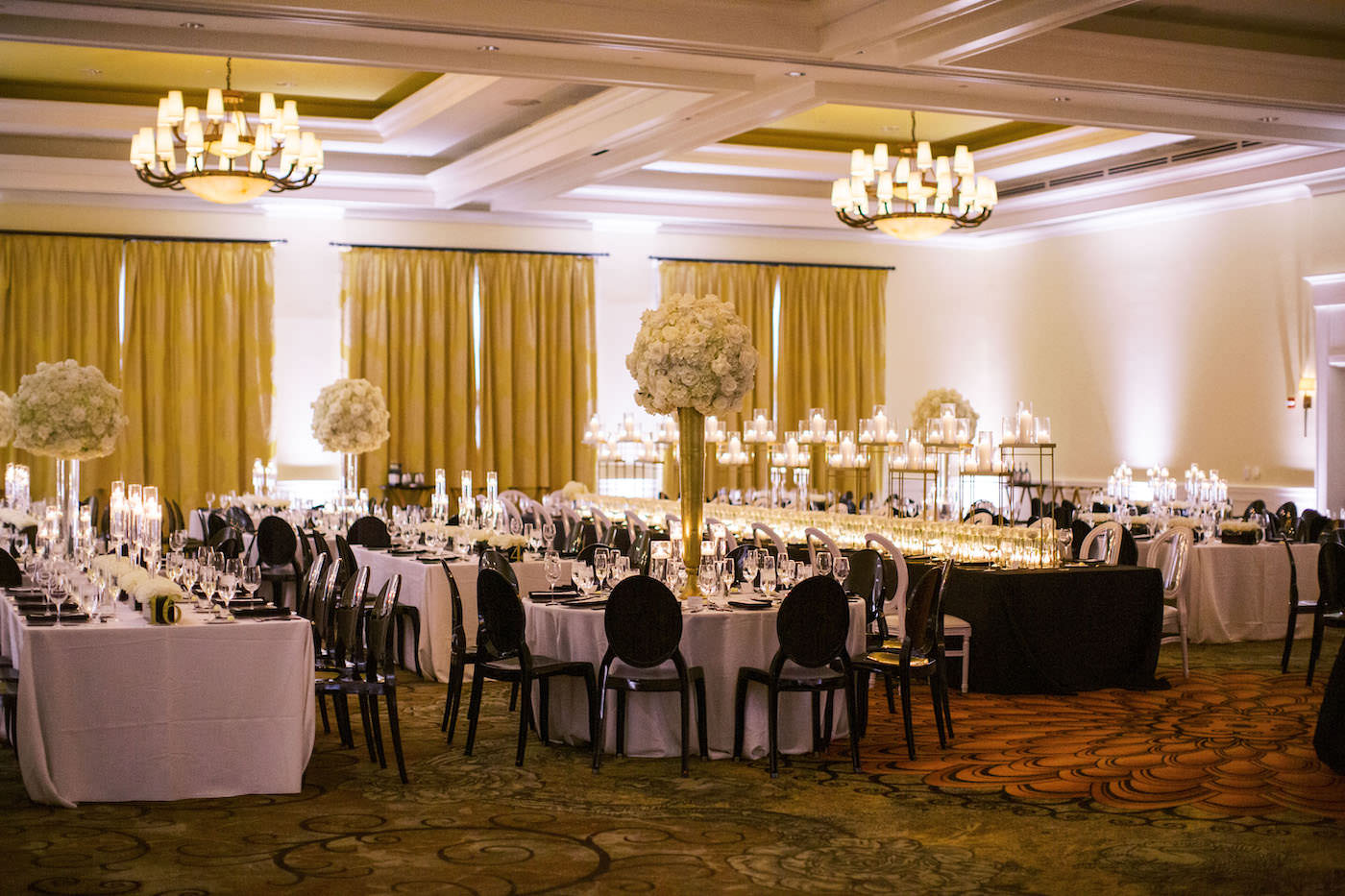 Classic Timeless Elegant Ballroom Wedding Reception Decor, Long Tables with White Linens, Black Chairs, Tall Gold Vases with White Floral Centerpieces | Clearwater Beach Wedding Hotel Venue Sandpearl Resort | Tampa Bay Wedding Planner Parties A'la Carte