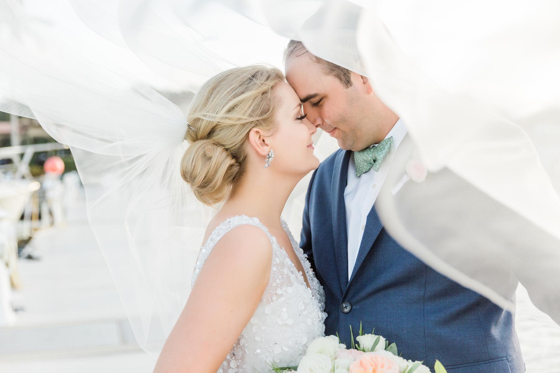Destination Florida Bride and Groom Wedding Portrait with Flying Veil