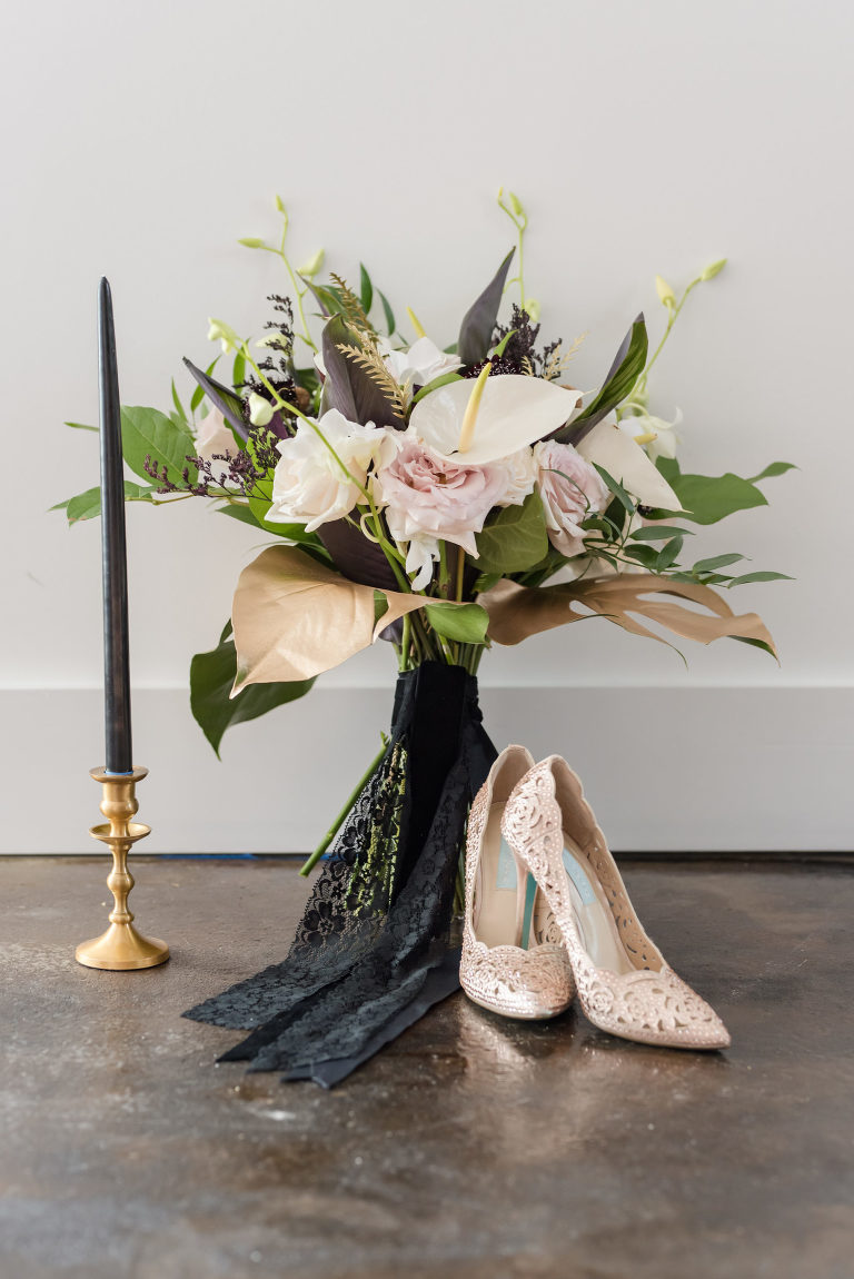 Dark Luxe Style Shoot, White Calla Lily, Blush Pink Roses, Greenery and Gold Tropical Palm Leaves, Black Candlestick on Gold Stand, Rose Gold Pointed Toe Wedding Shoes | Tampa Bay Wedding Planner Elegant Affairs by Design