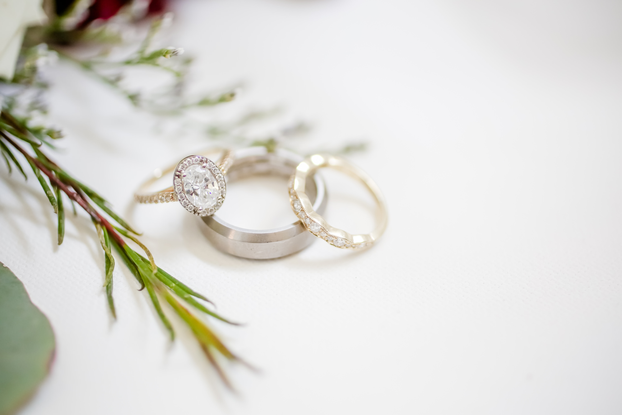 Florida Wedding Rings Detail Shot, Oval Diamond Halo Engagement Ring with Yellow Gold and Silver Bride and Groom Bands   Tampa Bay Wedding Photographer Lifelong Photography Studio