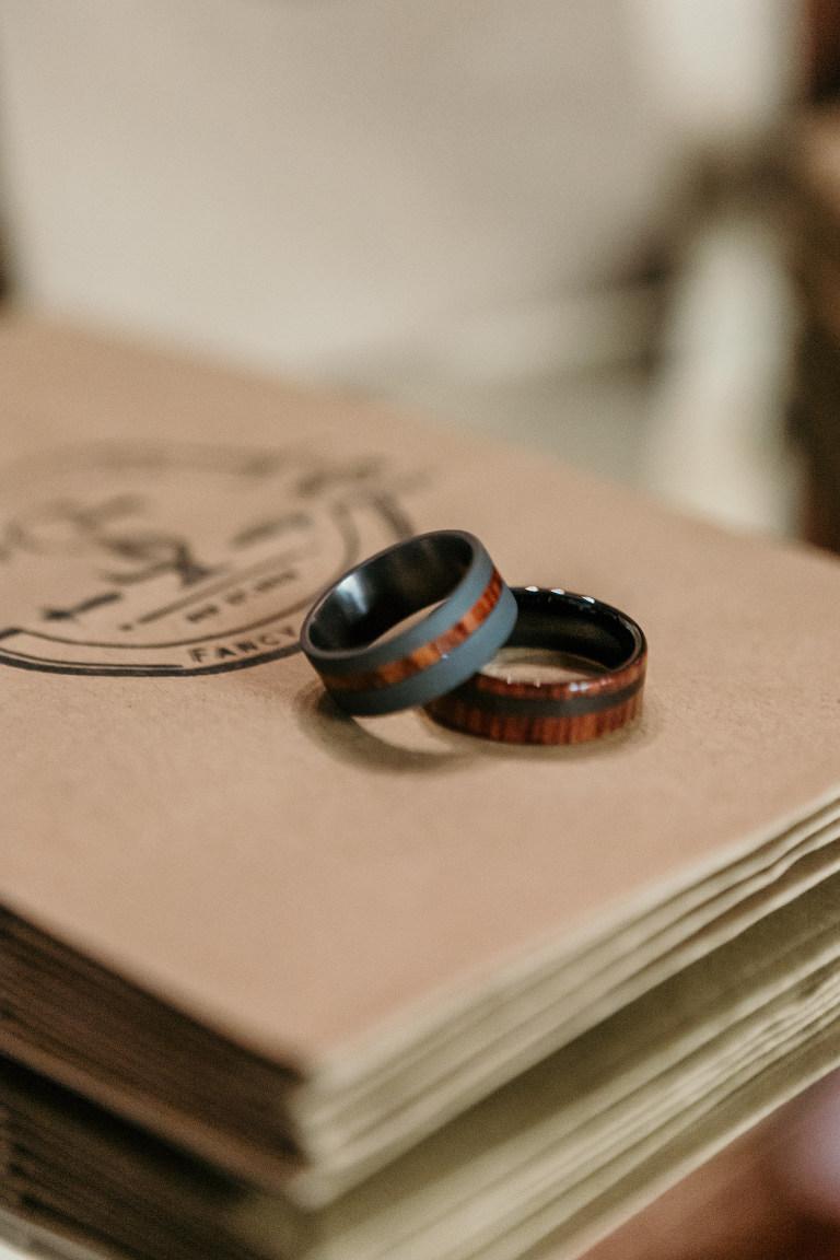 Same Sex Tampa Gay Grooms Black and Wood Grain Wedding Rings
