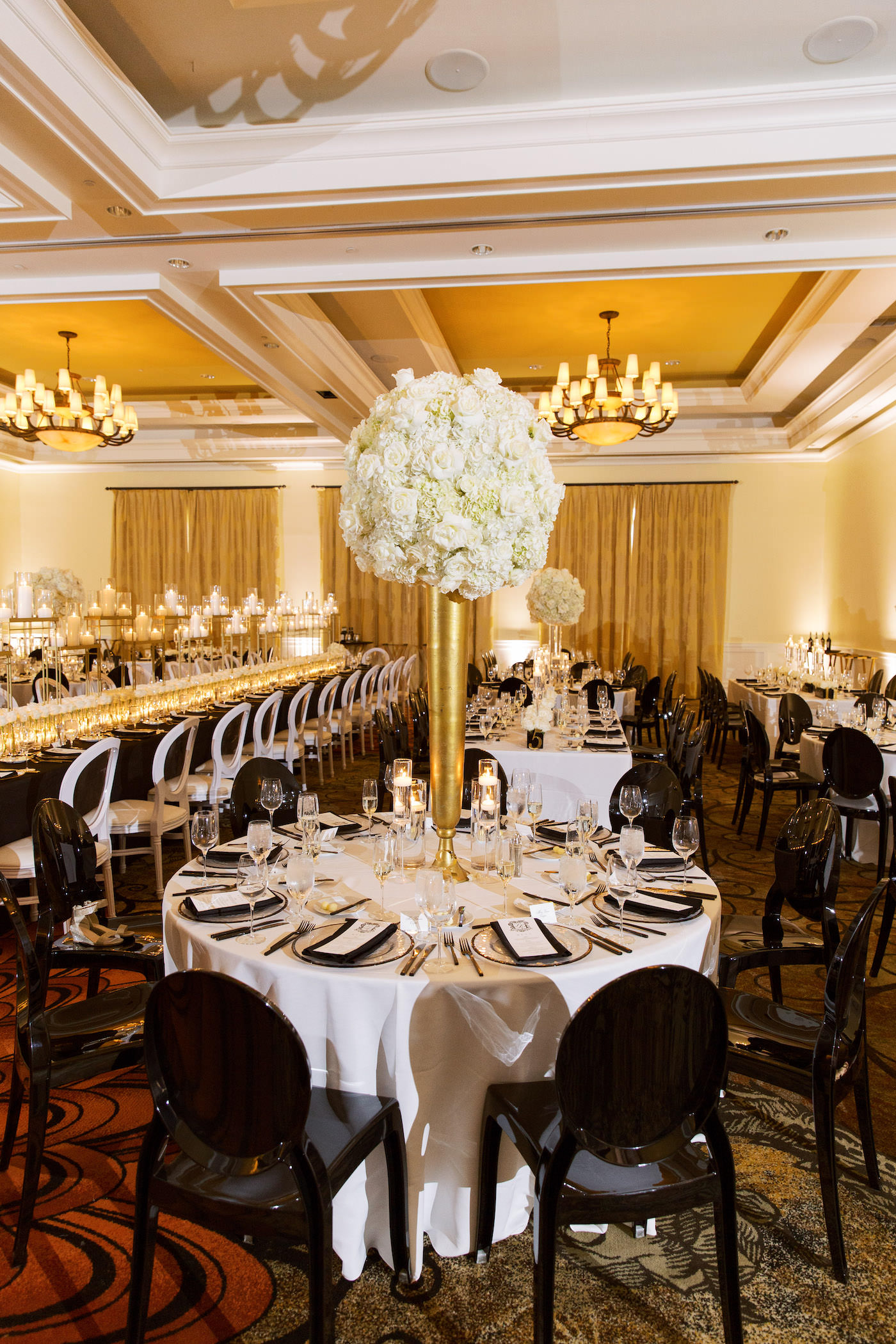 Classic Timeless Elegant Ballroom Wedding Reception Decor, Round Table with White Linen, Black Chairs, Tall Gold Vase with White Hydrangeas Centerpiece | Clearwater Beach Hotel Wedding Venue Sandpearl Resort | Tampa Bay Wedding Planner Parties A'la Carte