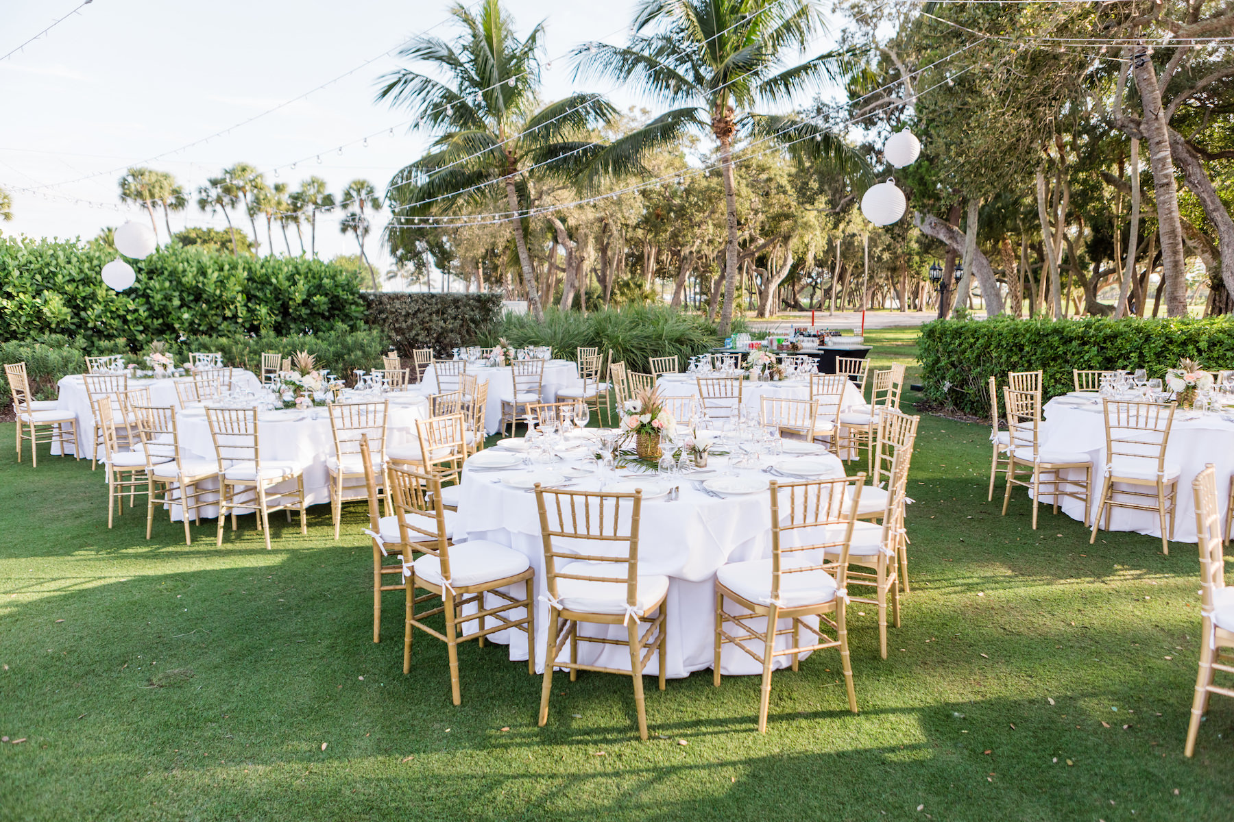 Elegant Outdoor Florida Lawn Wedding Reception with Hanging White Lanterns, White Linens and Gold Chiavari Chairs | Sarasota Wedding Venue The Resort at Longboat Key Club