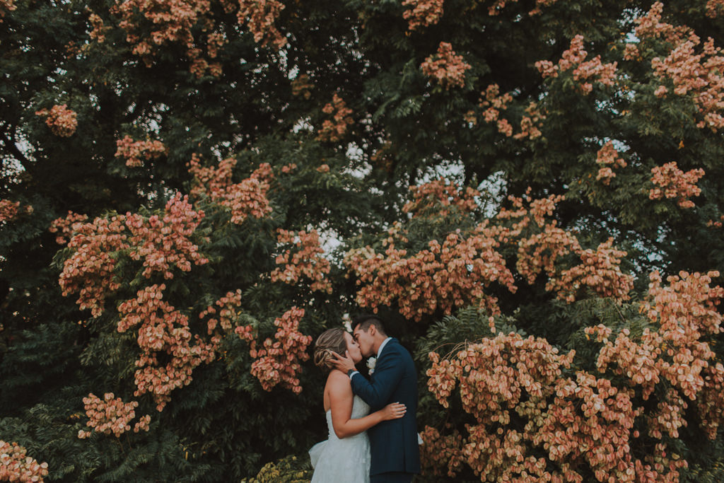 Outdoor Lush Garden Bride and Groom Portraits with Floral Backdrop