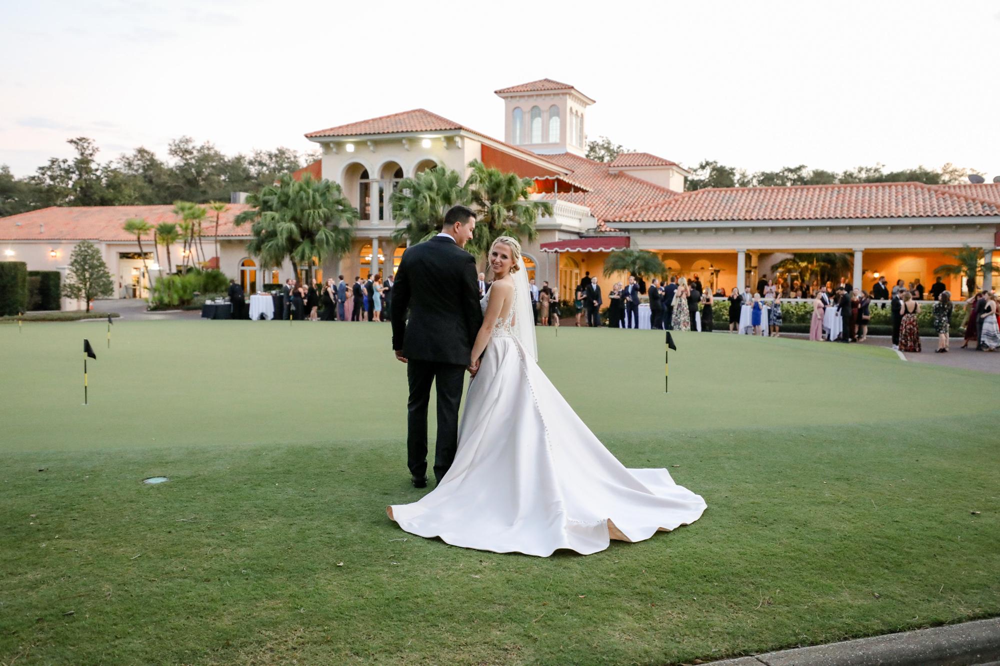 Bride and Groom Outdoor Golf Course Putting Green Wedding Photo | | Photographer Lifelong Photography Studio | Tampa Wedding Venue Avila Golf & Country Club |