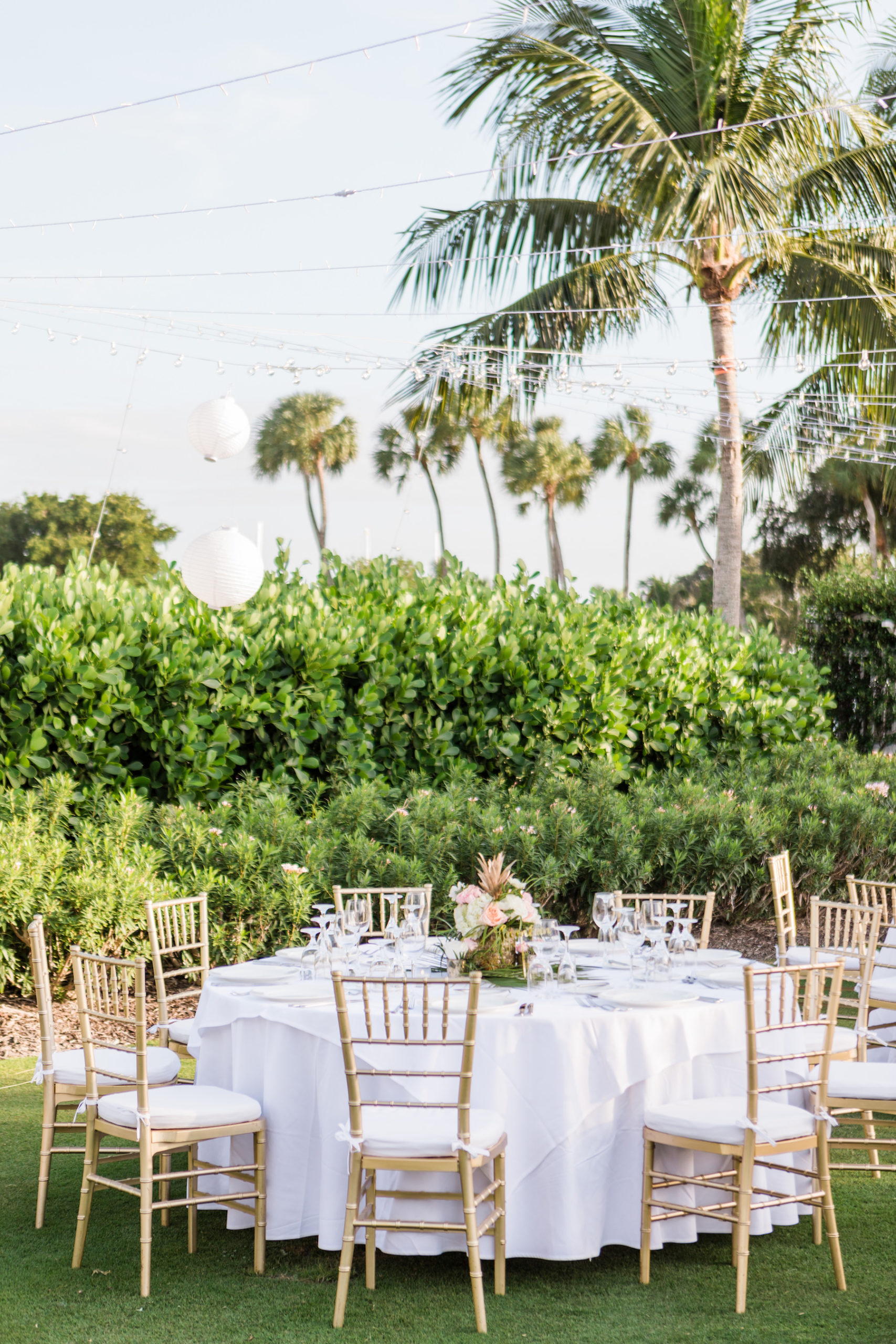 Tropical Outdoor Florida Lawn Wedding Reception with Hanging White Lanterns, White Linens and Gold Chiavari Chairs | Sarasota Wedding Venue The Resort at Longboat Key Club
