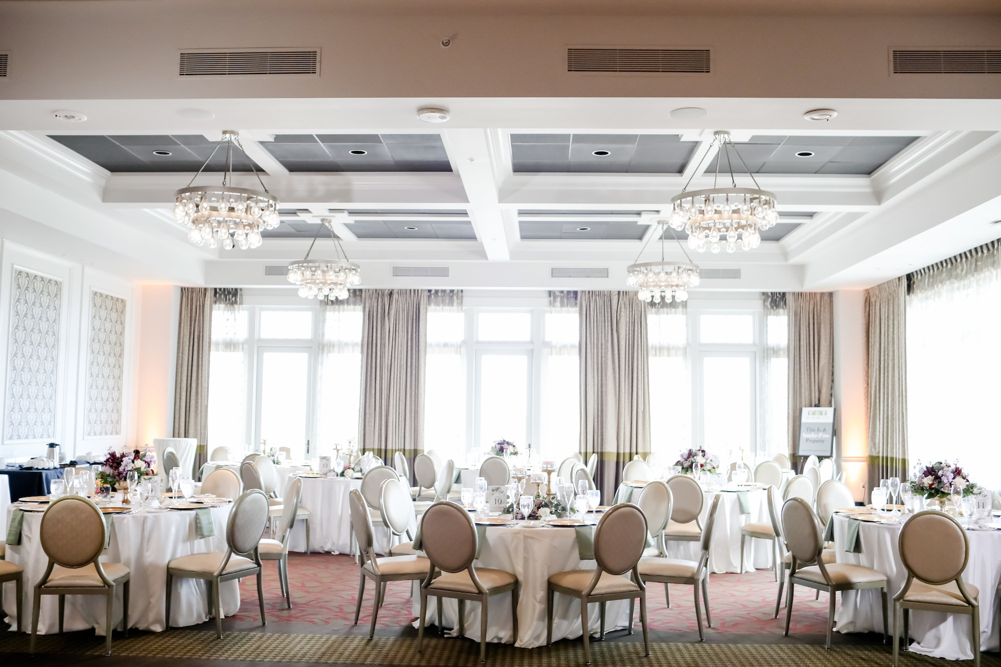 Classic Spring Time Inspired Wedding Reception in Chic Ballroom with Natural Lighting, Round Tables with White Linens, Modern Lighting Fixtures and Chandeliers   Florida Boutique Hotel The Birchwood   Tampa Bay Wedding Photographer Lifelong Photography Studio   Planner Blue Skies Weddings and Events