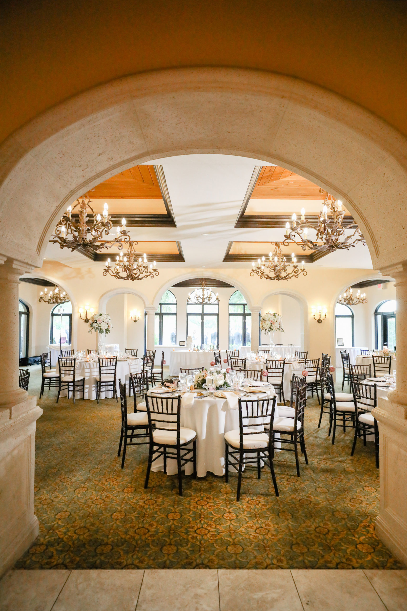 Tampa Wedding Venue Avila Golf & Country Club | Indoor Ballroom Reception with Black Chiavari Chairs and Chandeliers
