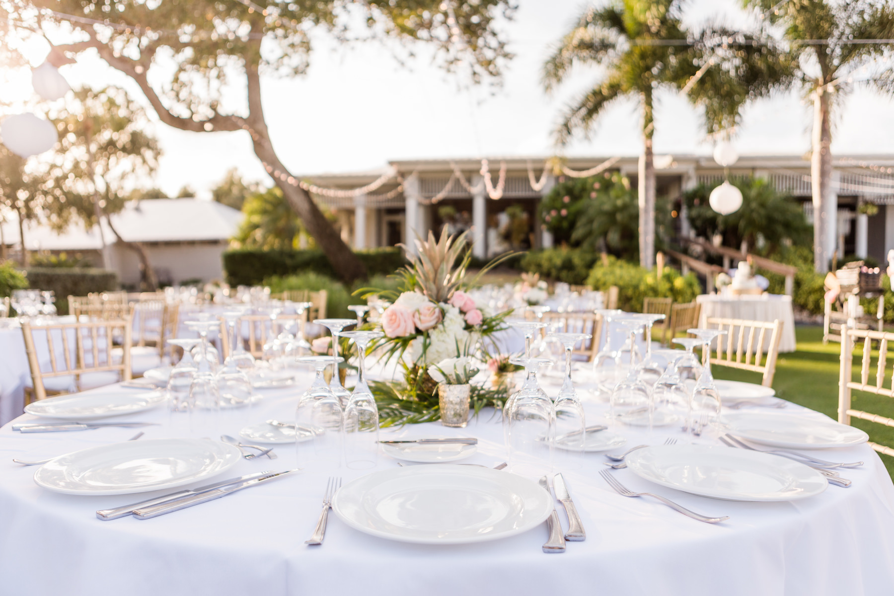 Elegant Outdoor Florida Lawn Wedding Reception with Hanging White Lanterns, White Linens and Peach, Pink and White Pineapple Centerpieces | Sarasota Wedding Venue The Resort at Longboat Key Club