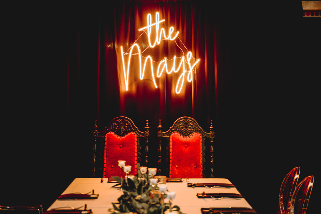 Bride and Groom Vintage Chairs with Neon Sign Backdrop
