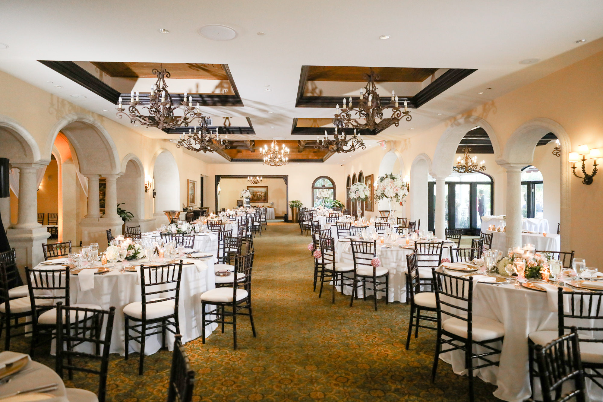 Romantic Indoor Ballroom Reception with Black Chiavari Chairs and Chandeliers | White Linens and Low Blush Pink Dusty Rose Centerpieces | Elegant Tampa Wedding Venue Avila Golf & Country Club