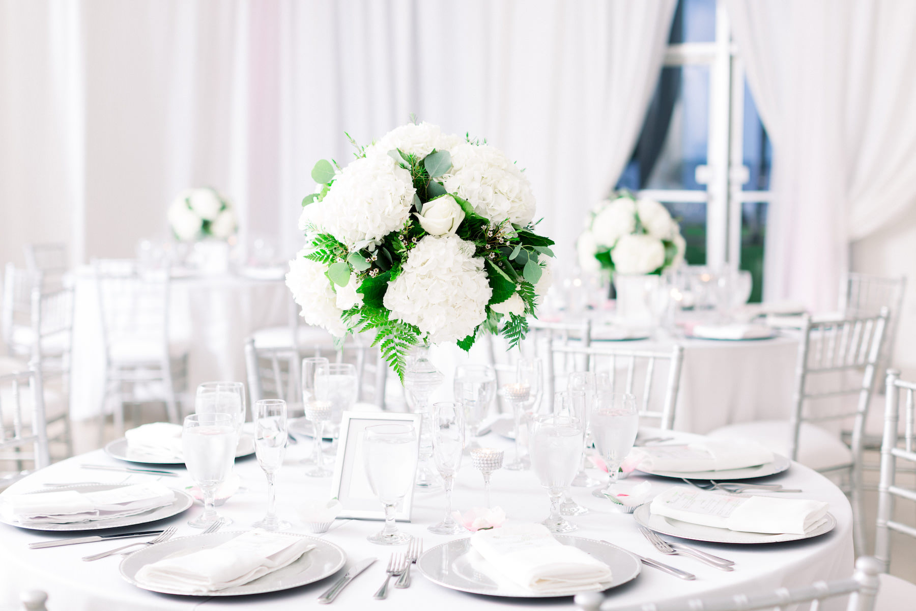 Classic Garden Glam Wedding Reception Decor, Silver Chargers, White Hydrangeas and Roses with Greenery Floral Centerpiece, Silver Chiavari Chairs | Wedding Venue Tampa Garden Club | Wedding Photographer Shauna and Jordon Photography